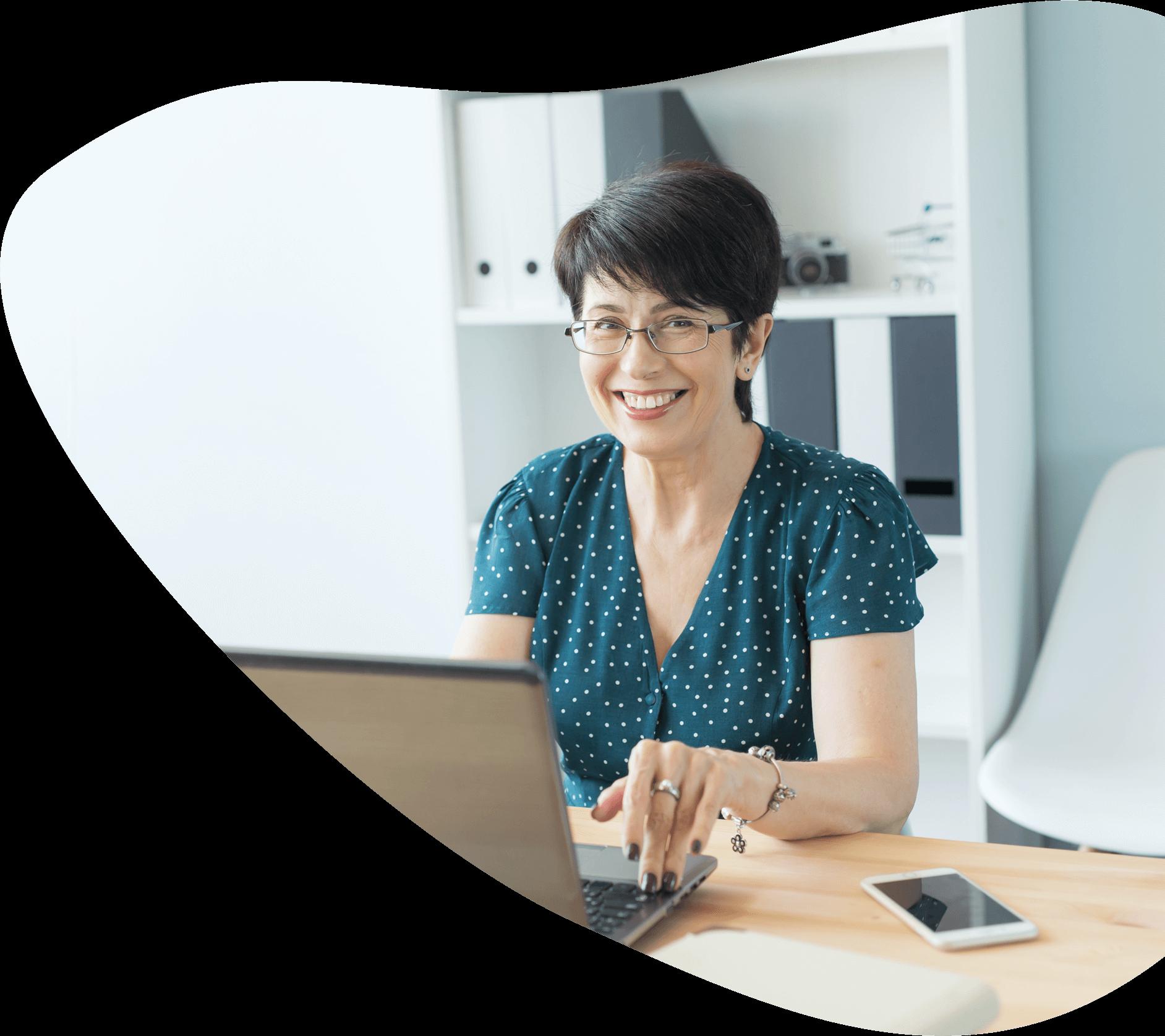 woman at desk, smiling