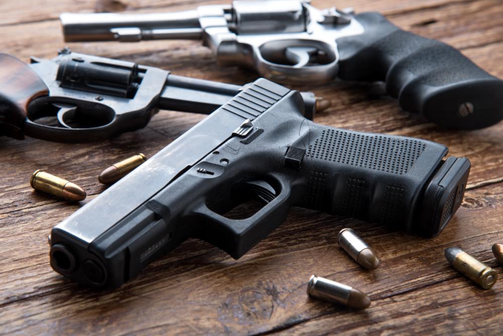Various handguns on a table