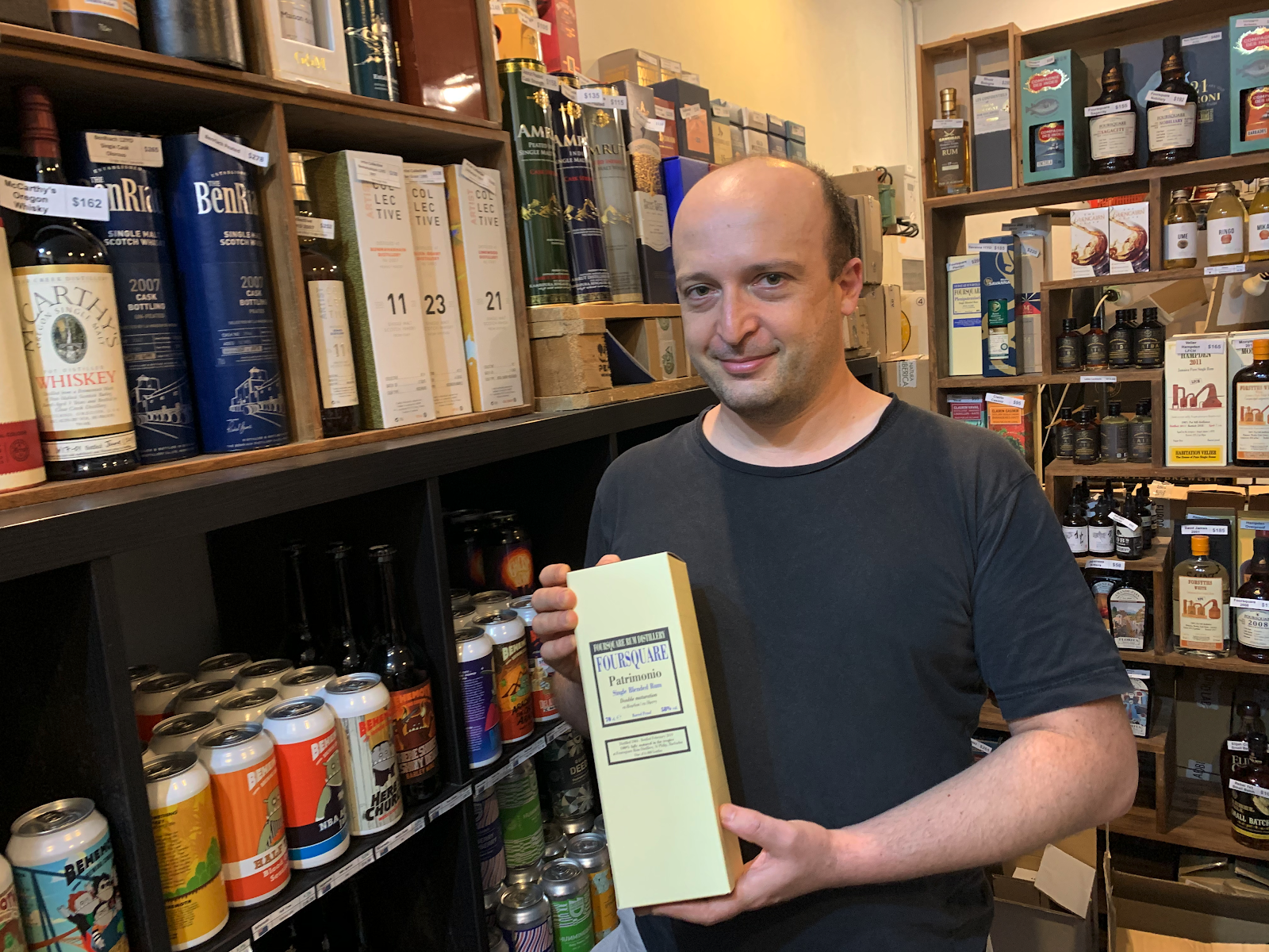 Luc strikes a pose with a bottle of Foursquare Rum