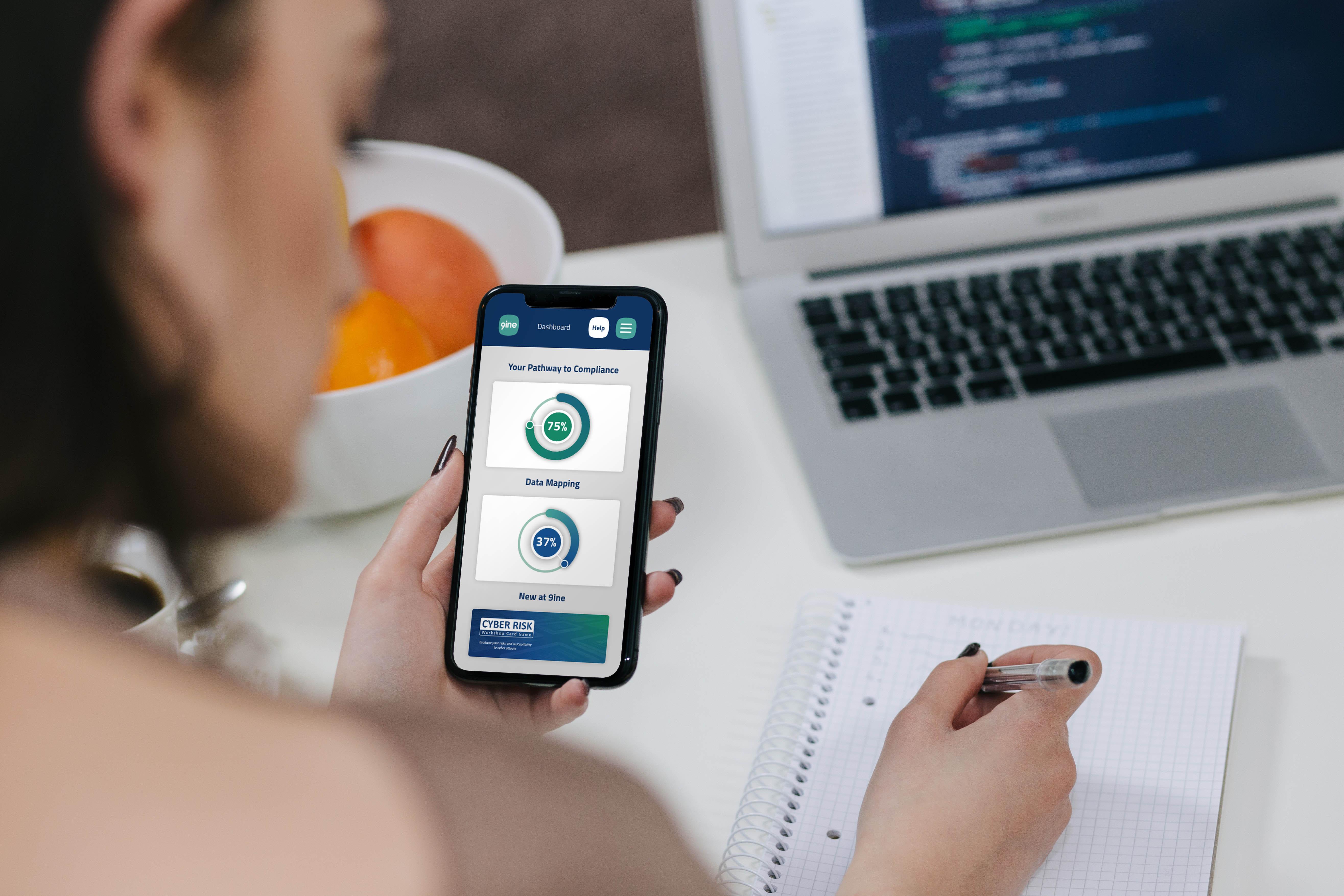 Woman using phone showing 9ine Web App