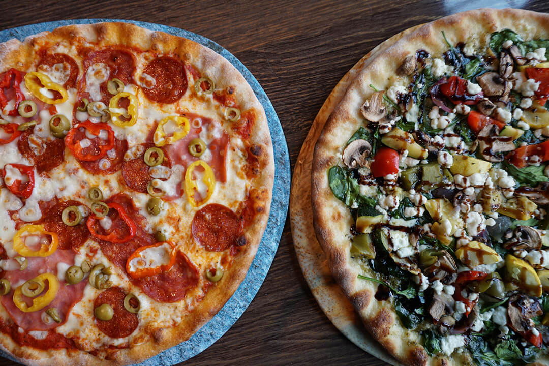 Left: Calabrese Pizza, Right: Roasted Veggie Pizza