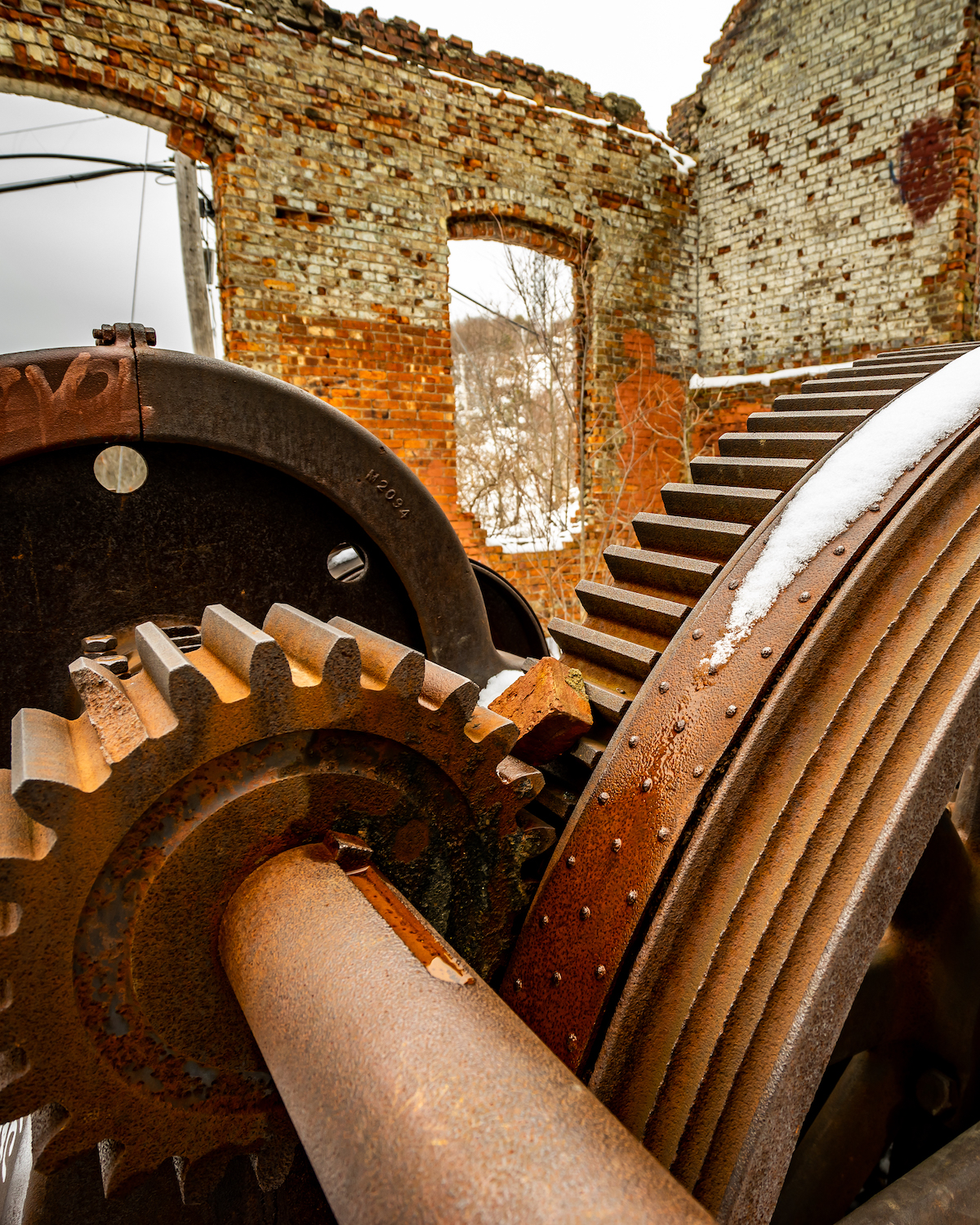 Rusty gears with a brick clogging them