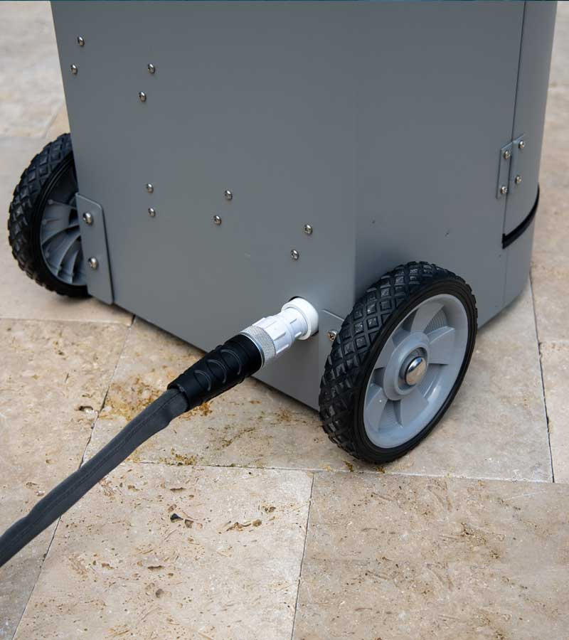 A rear facing shot of CleanSweep product showing an attached garden hose.