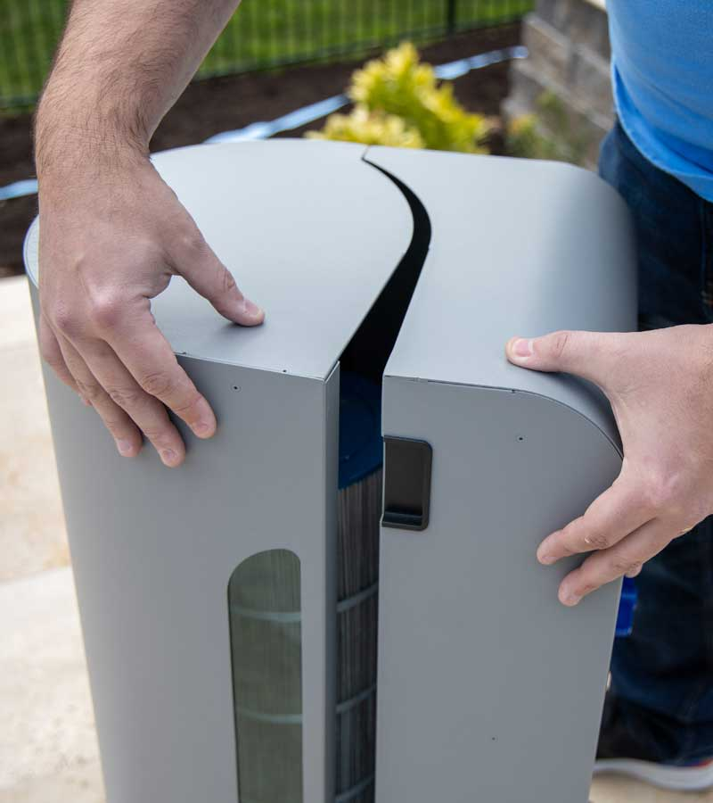 A side shot of CleanSweep product showing user closing the magnetic door.