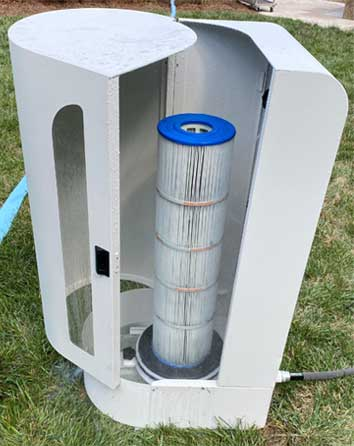 An early prototype of the CleanSweep product with a filter inside shortly after performing a test.