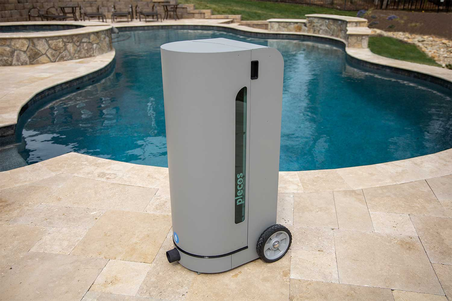 Image of CleanSweep product in front of a residential pool.