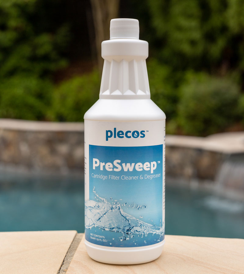 A picture of a PreSweep bottle placed on a table outdoors next to a pool.