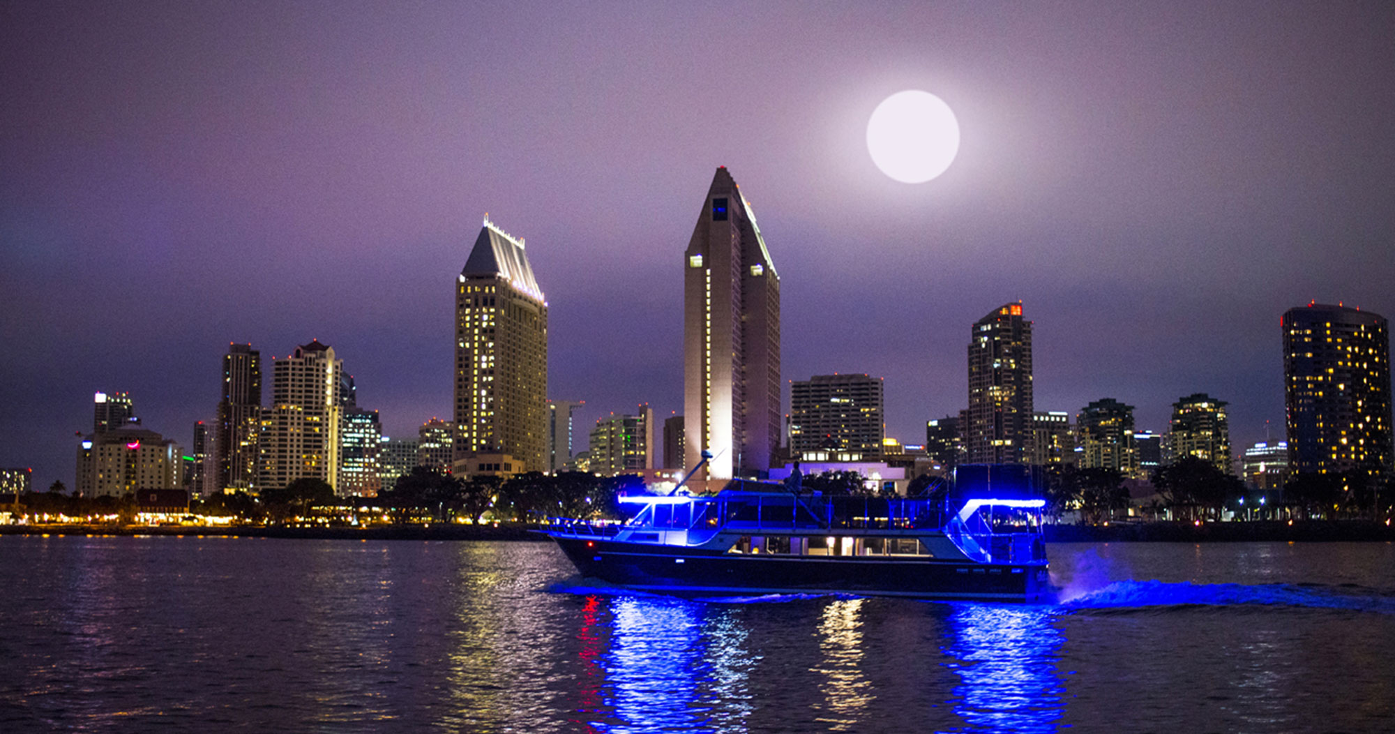 Bella Luna Yacht under the moon in the san diego bay