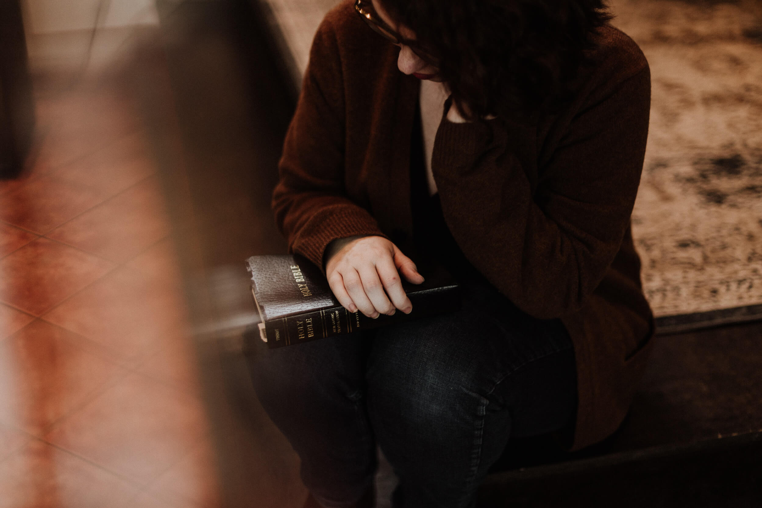 woman sitting with the Bible