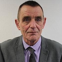 A portrait of Colin Hall, a TIGALA Guardian ad Litem.