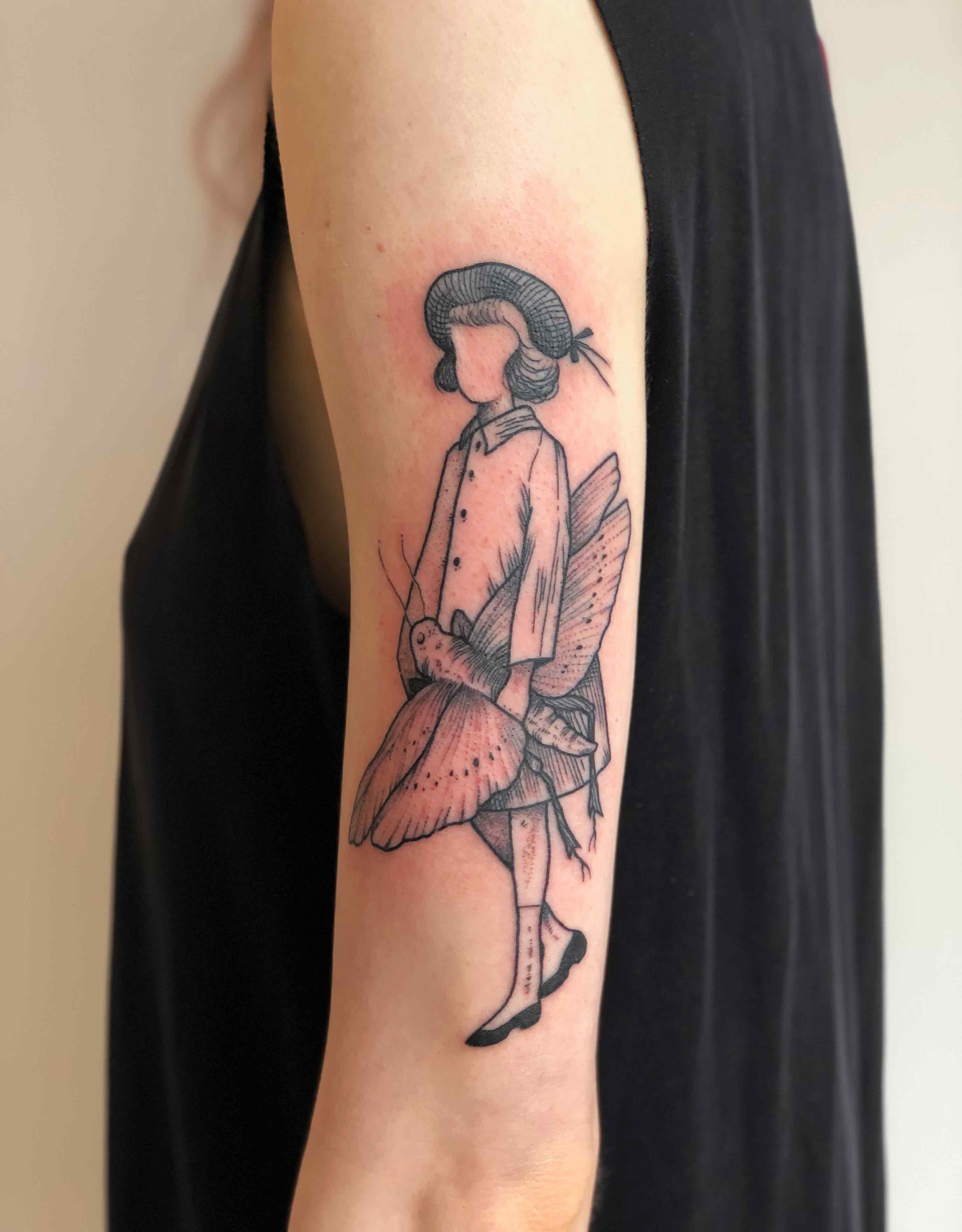 Florian Hirnhack Girl Holding Moth Arm Tattoo