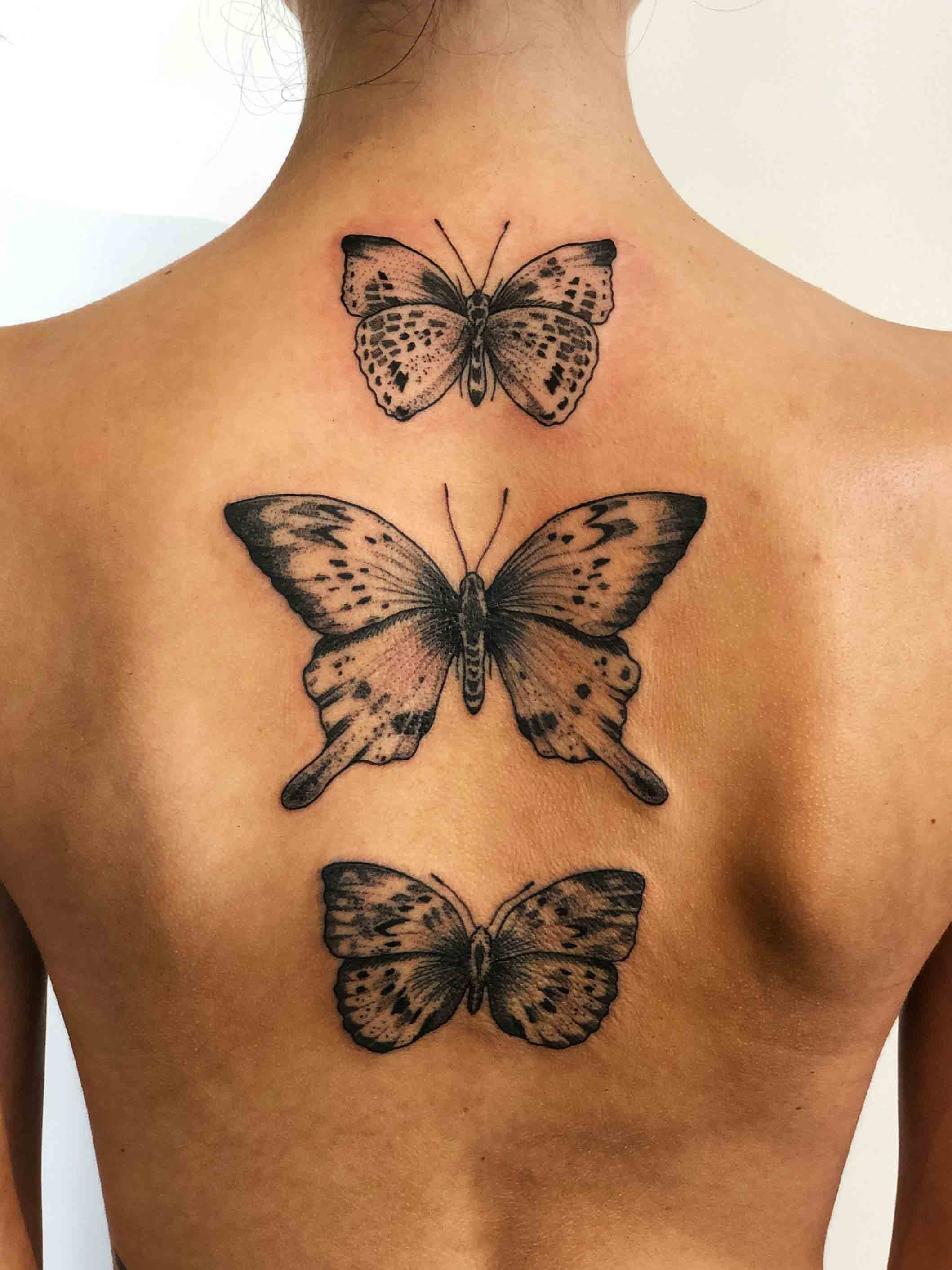 Florian Hirnhack Back Tattoo of Three Butterflies