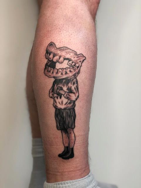 Florian Hirnhack Teeth with Body Leg Tattoo