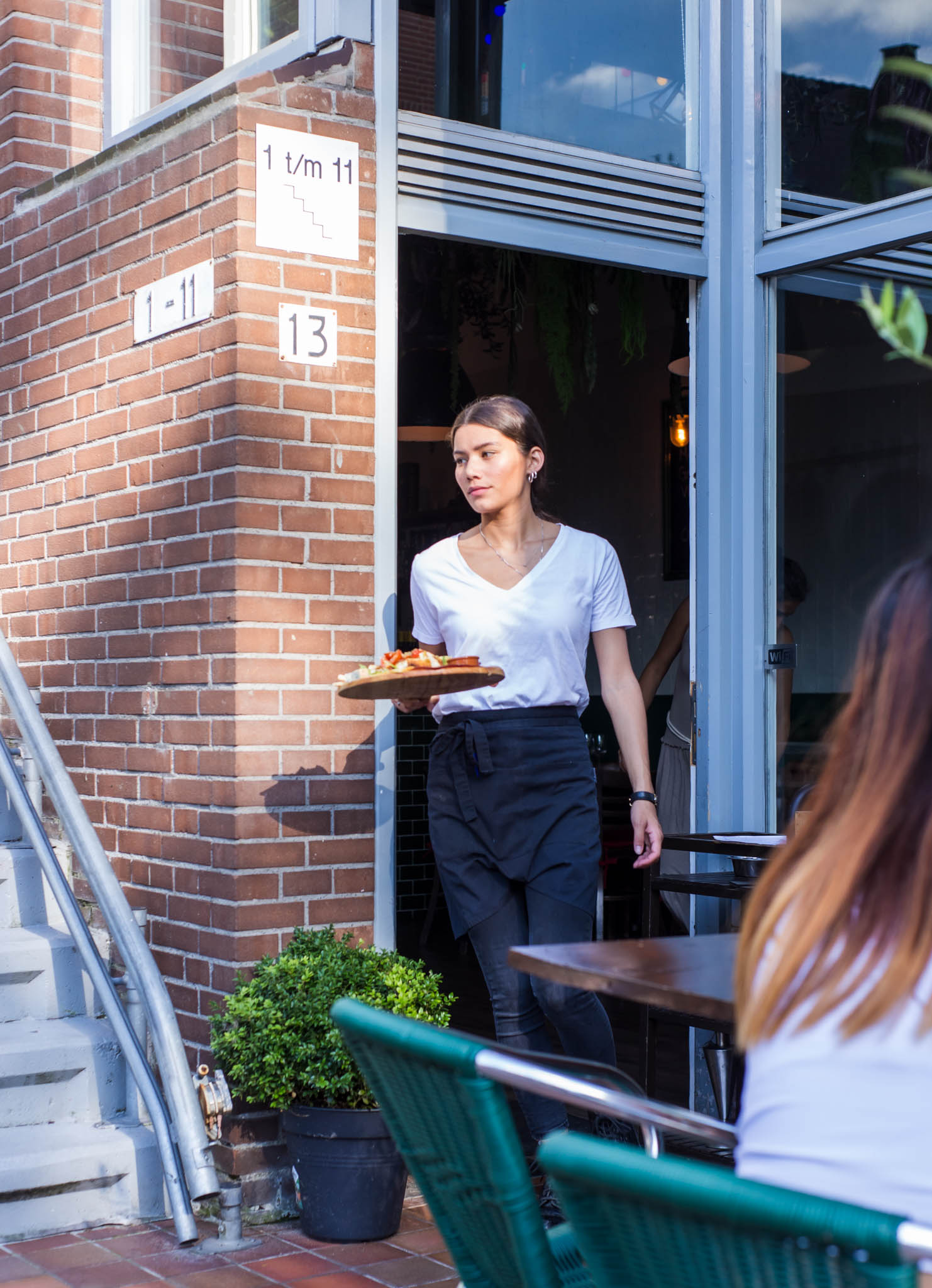 Waitress going outside a restaurant