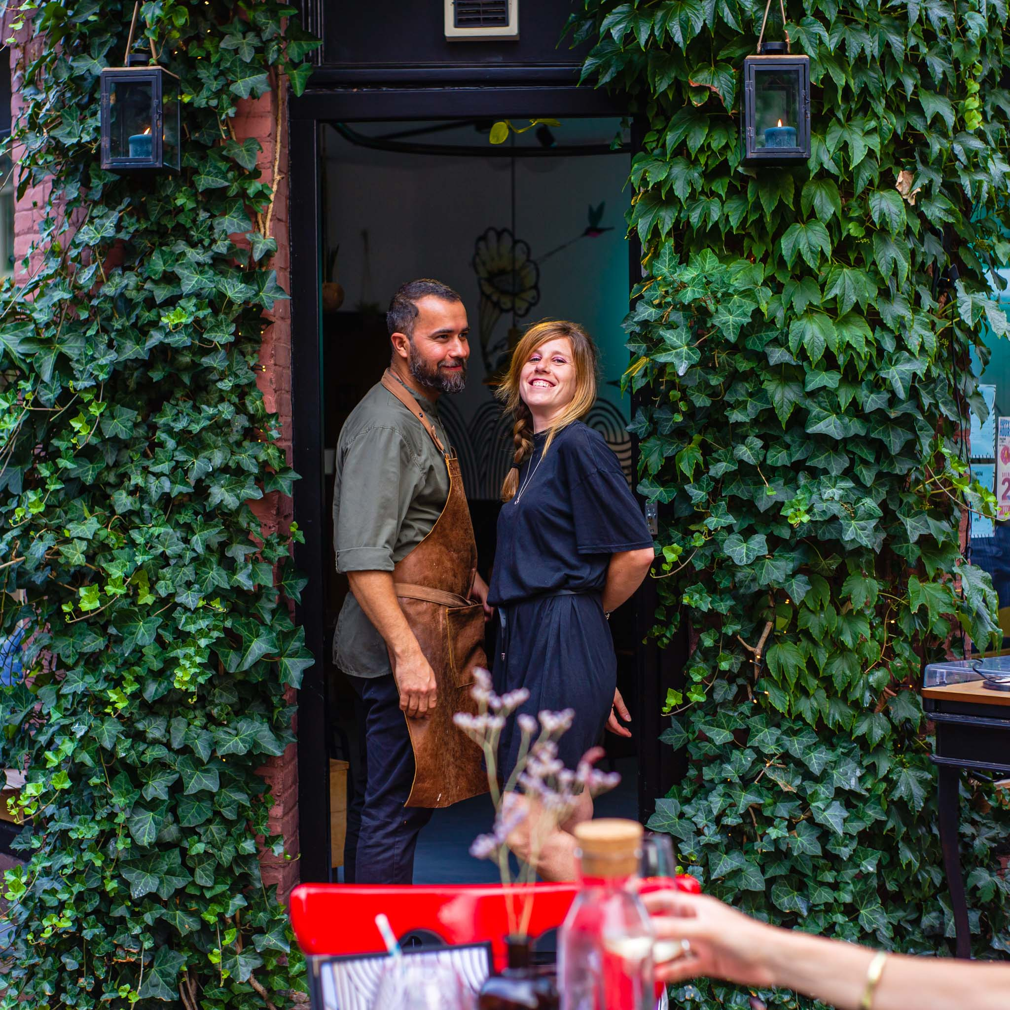 A couple standing at the door in Colibri restaurant in Amsterdam