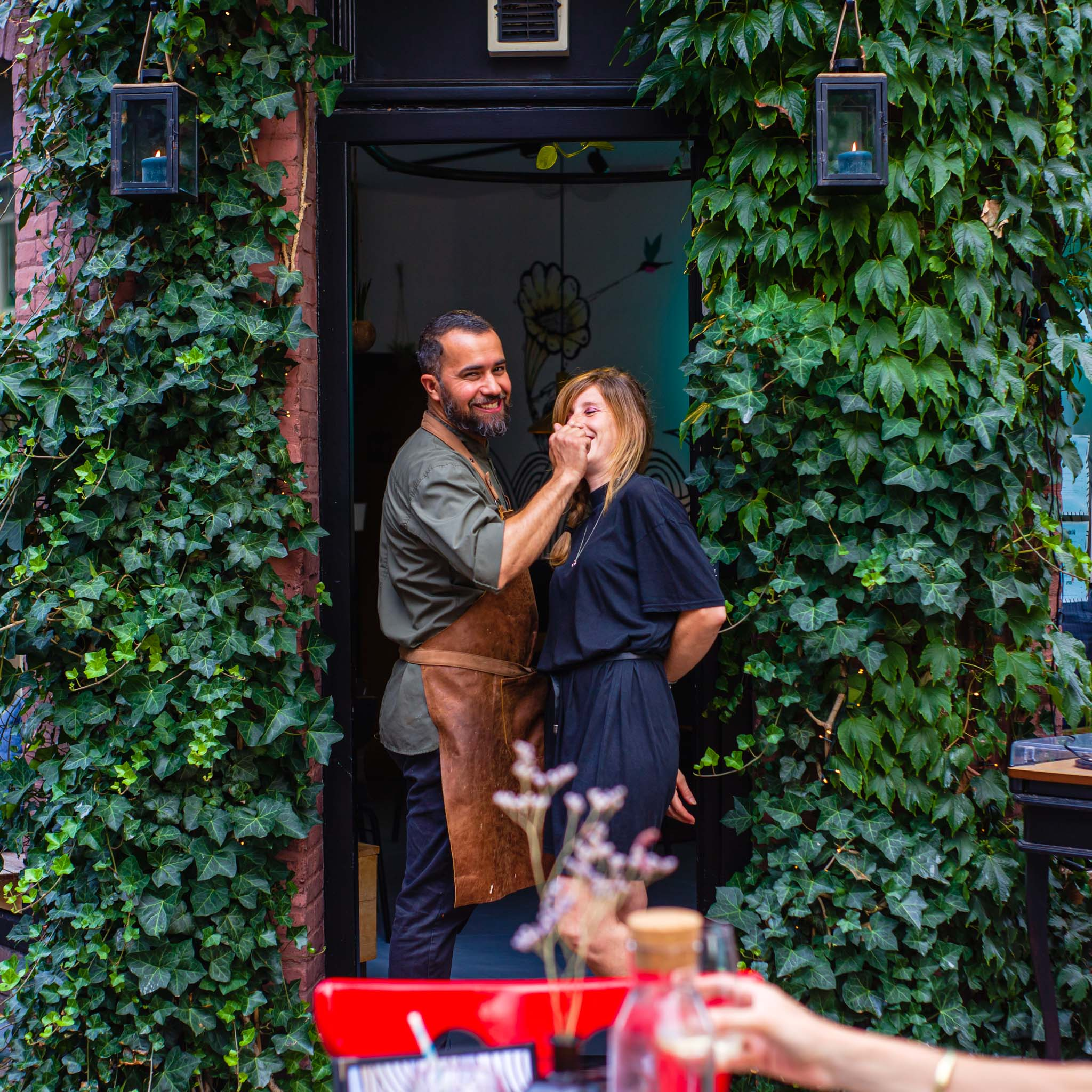 Couple at the door of a restaurant in Amsterdam