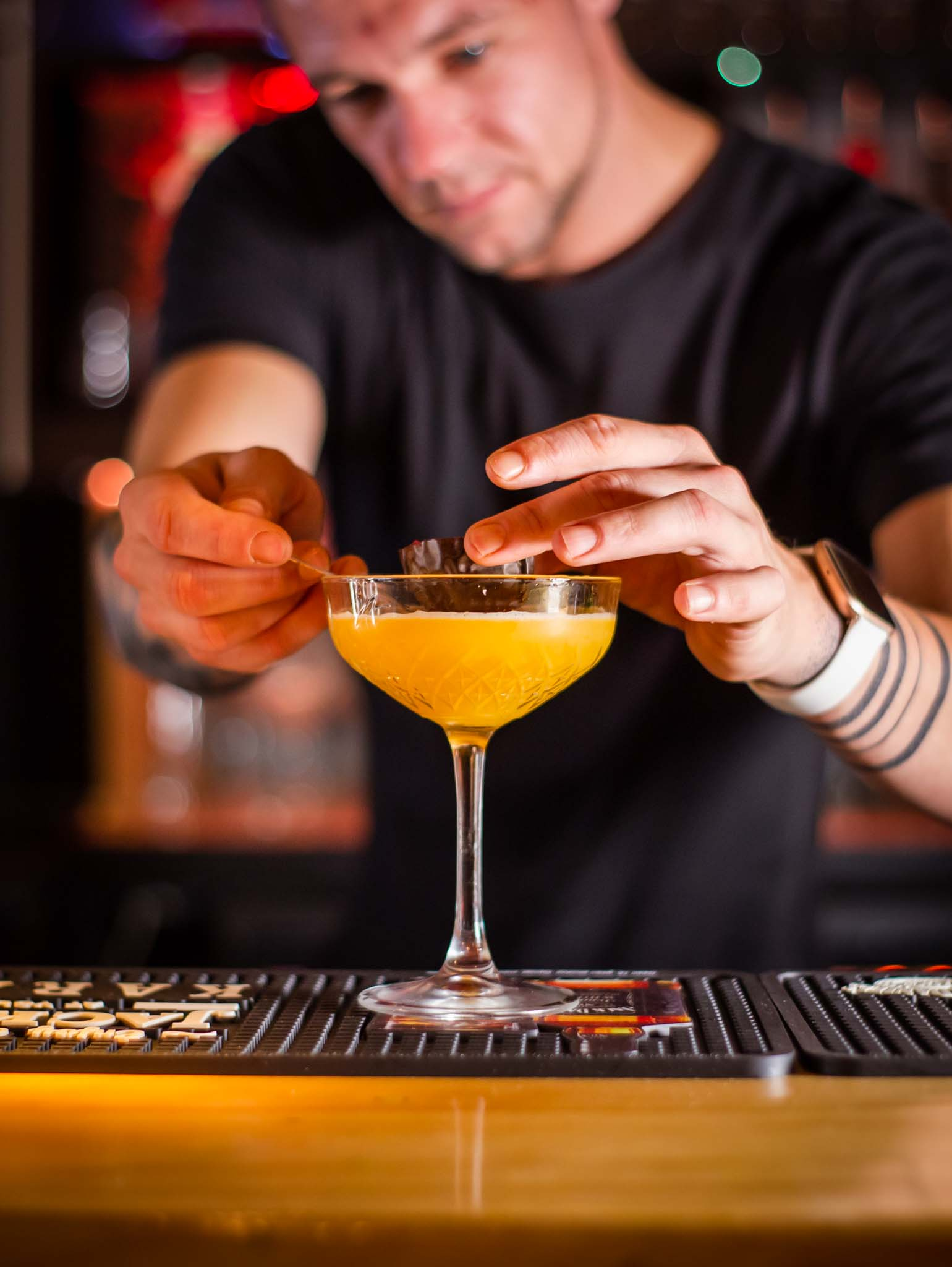 Bartender finishing cocktail in a bar