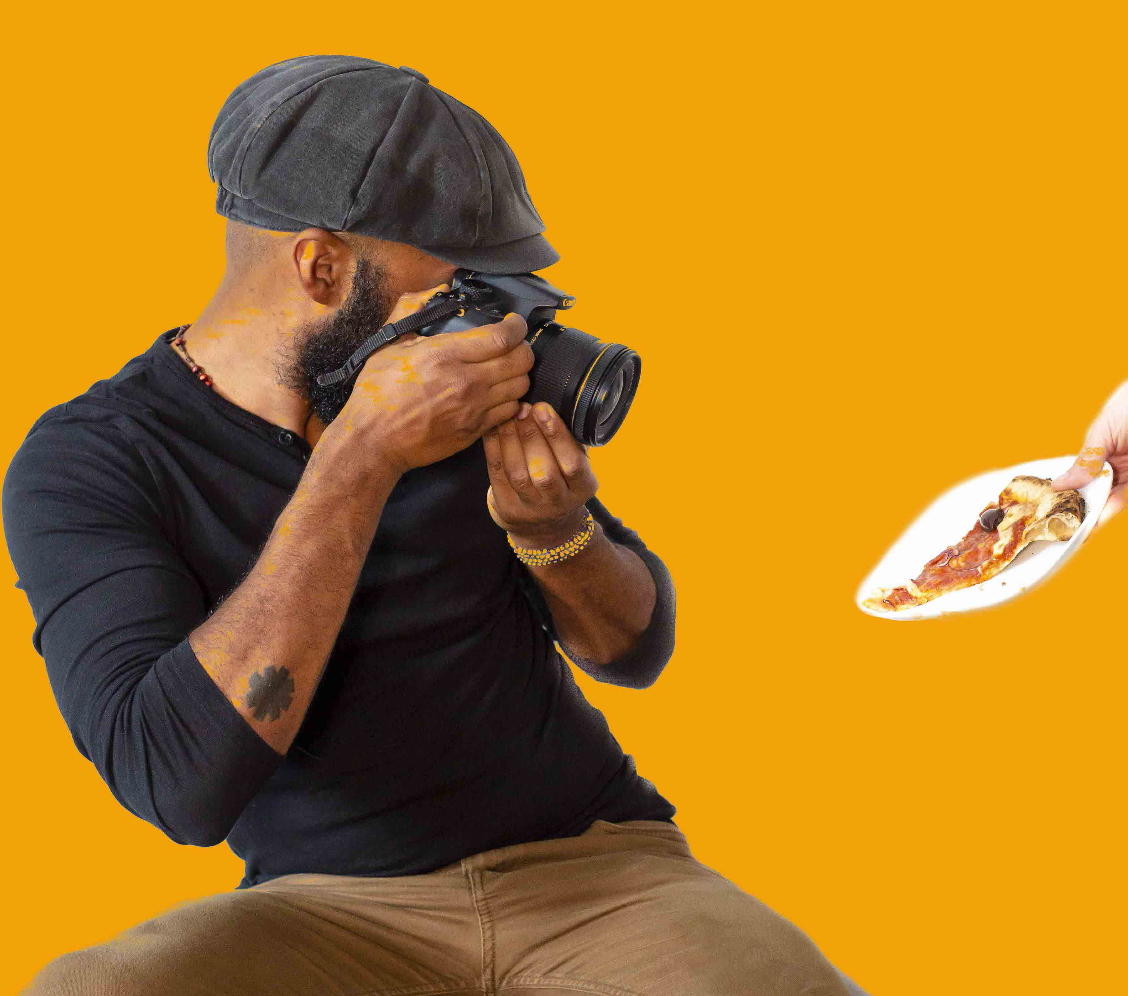 Photographer Louis Hansel taking photo of a slice of pizza