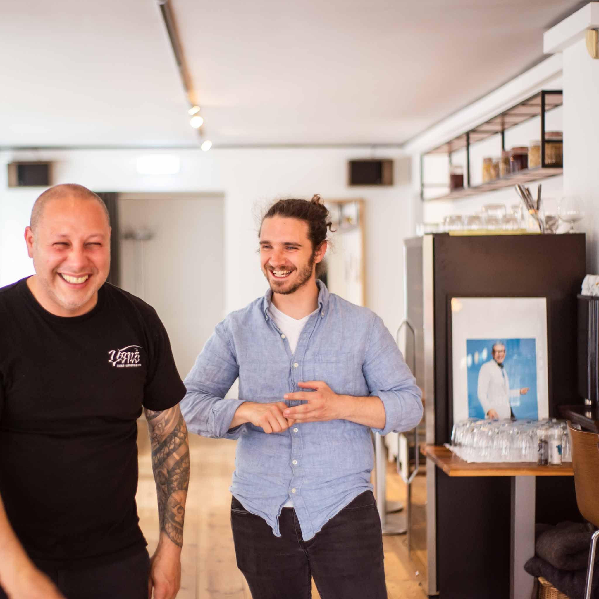 Portrait of cafe owners laughing
