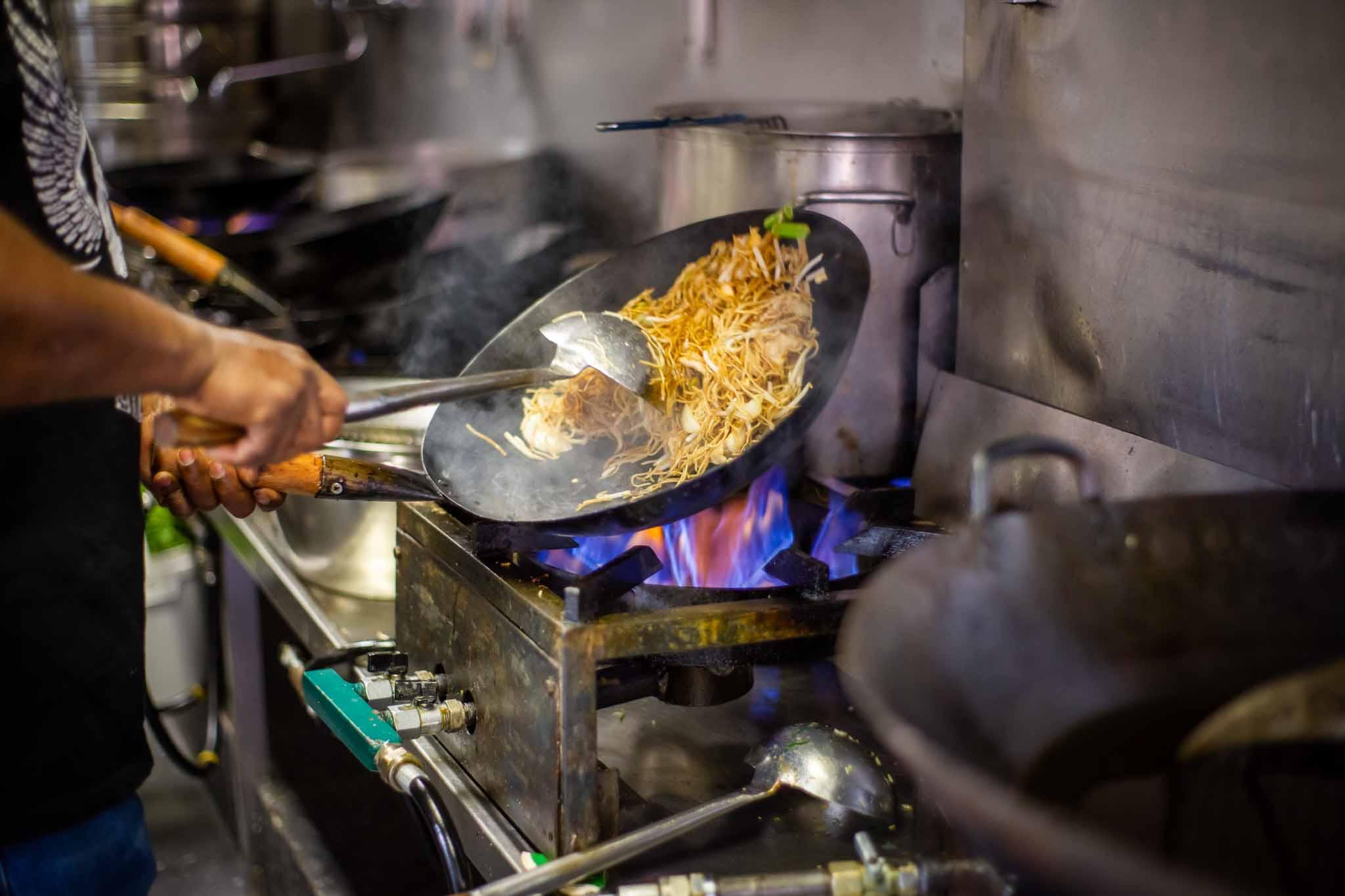 Chinese chef preparing stir fry dish