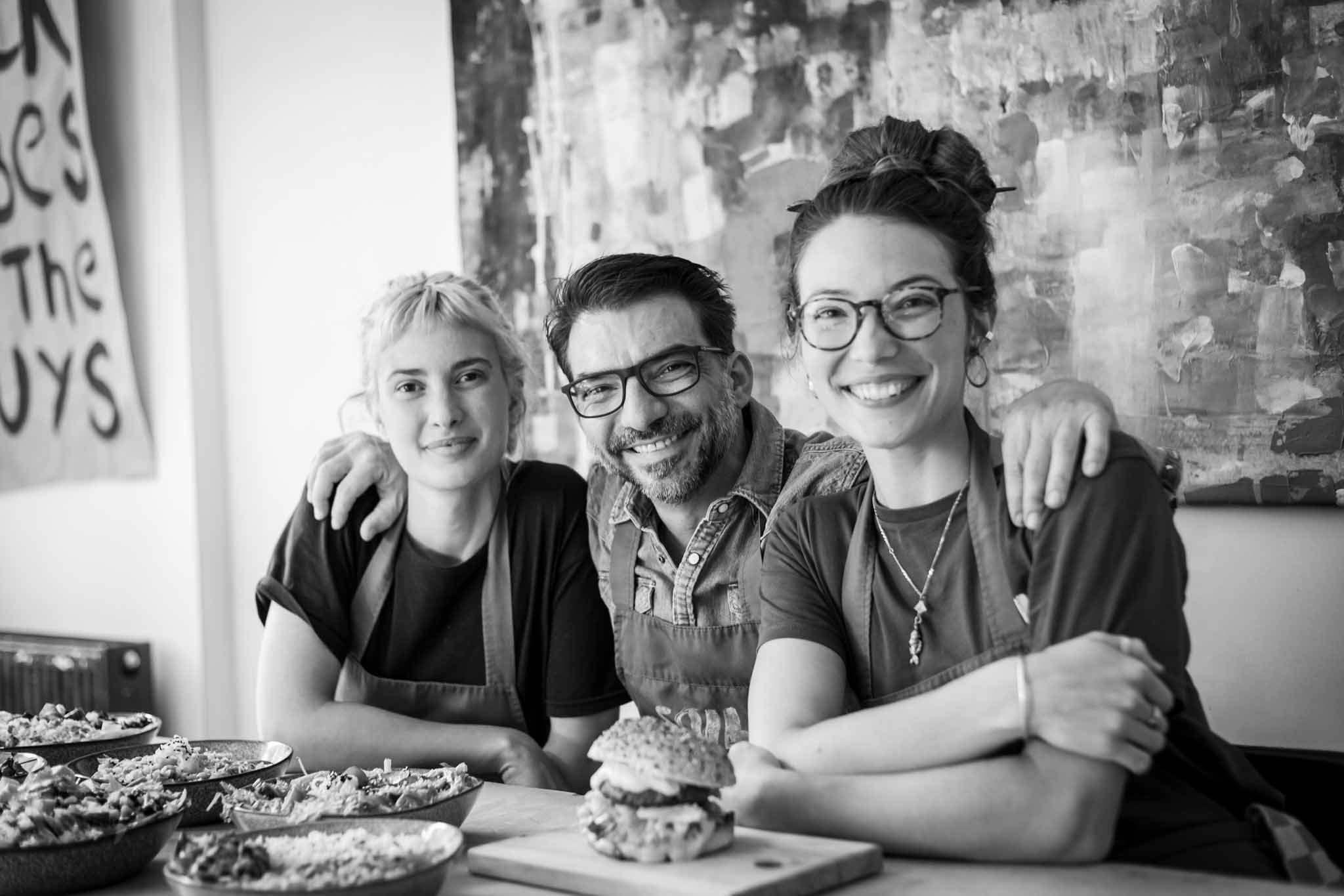 Portrait of restaurant owner with staff members in a restaurant