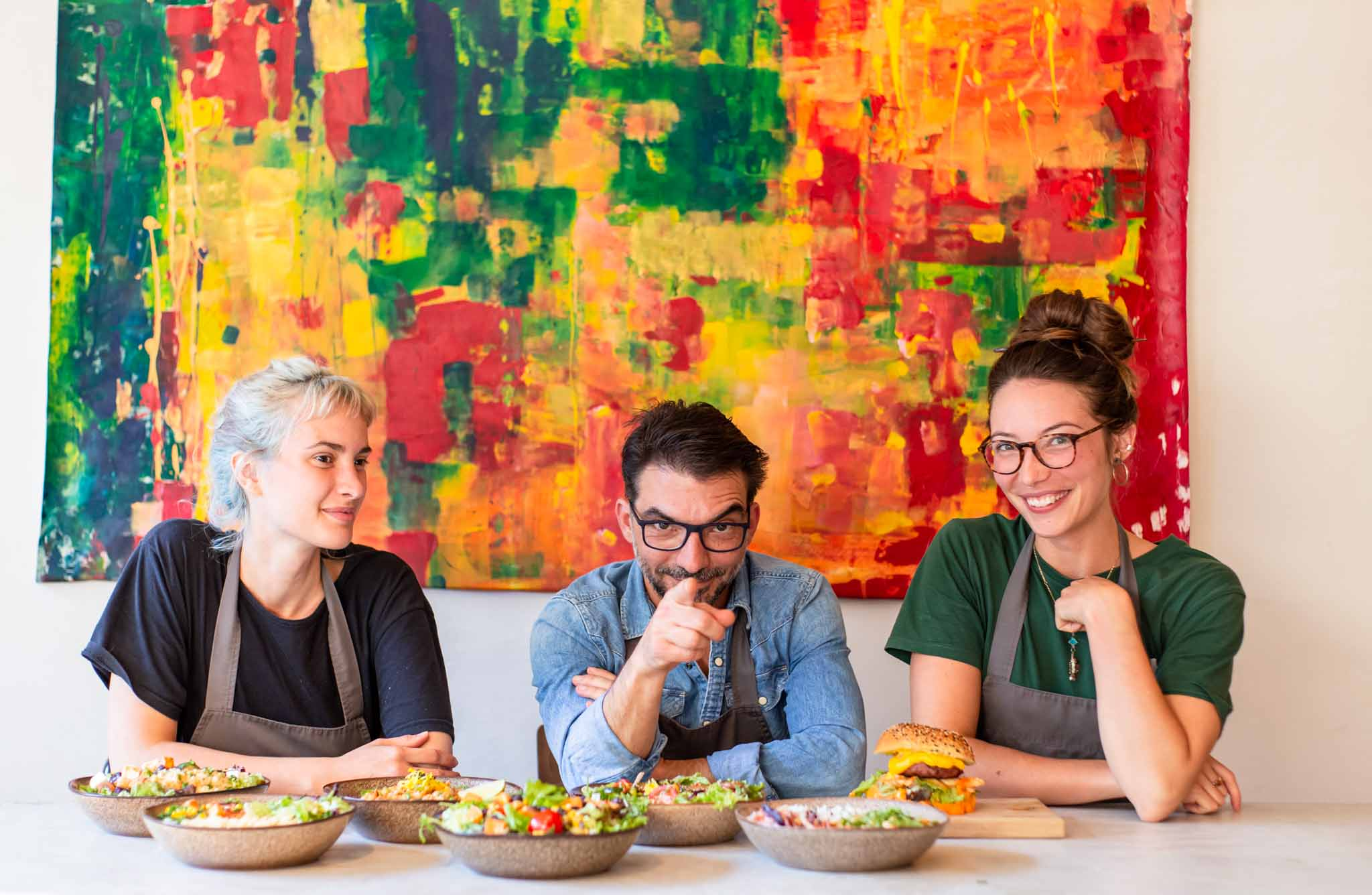 Portrait of restaurant owner and staff