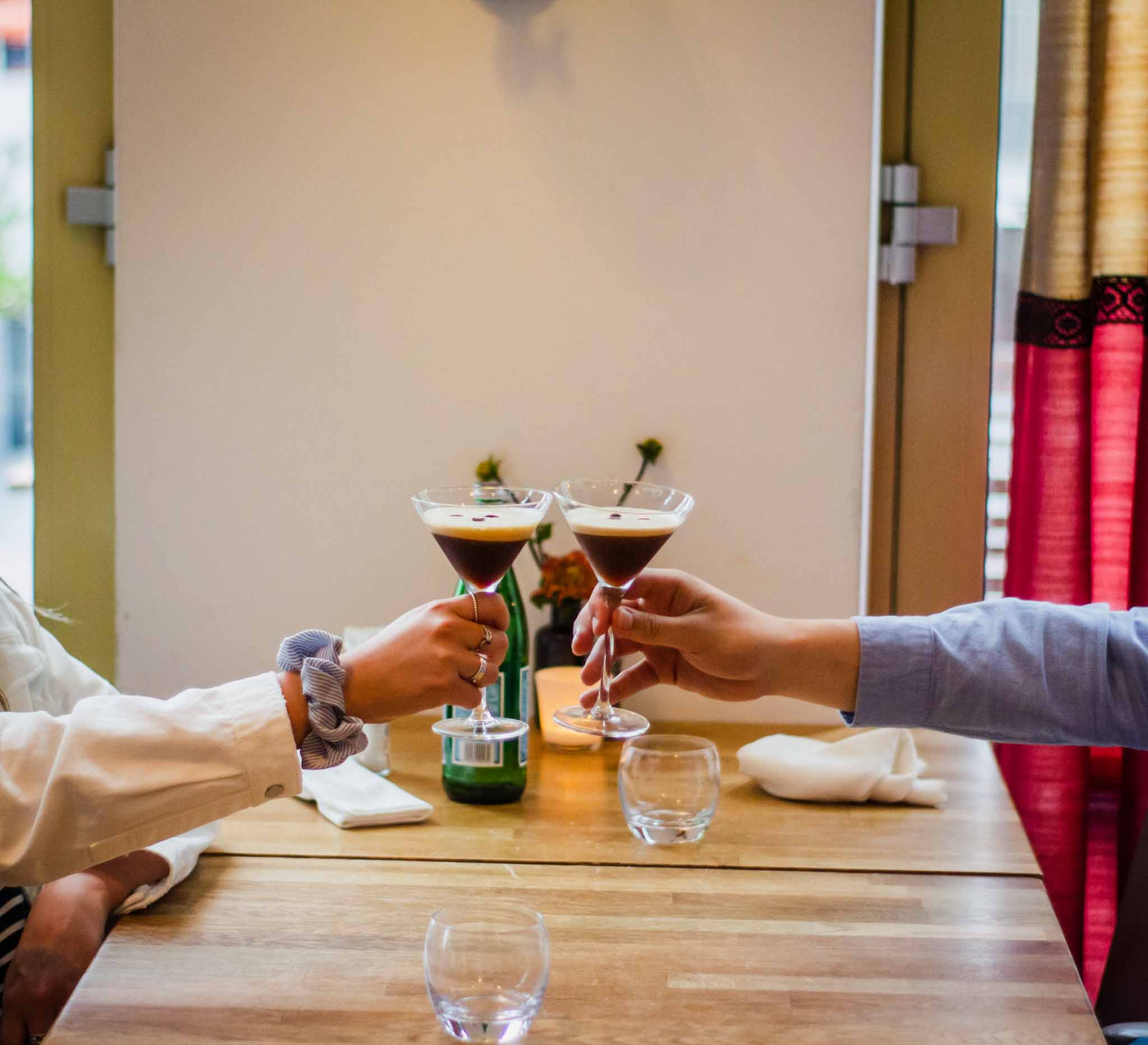 Couple raising the glasses for a toast in a Mediterranean restaurant