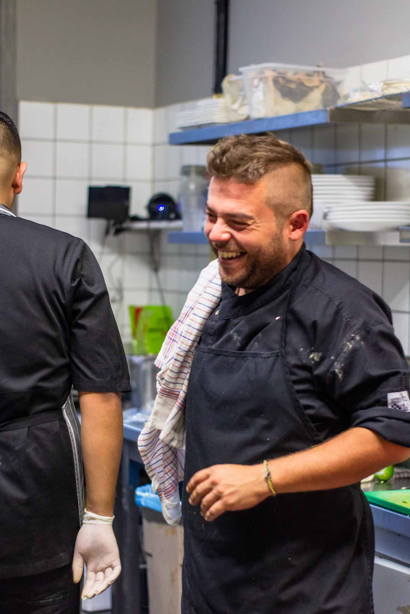 Two chefs in a Mexican restaurant sharing smiles
