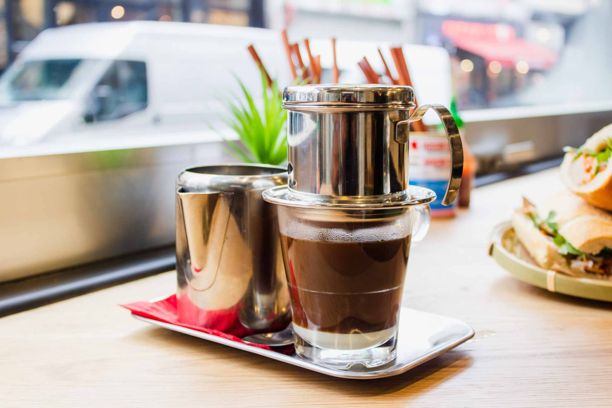 Vietnamese coffee and food on the table in a Vietnamese restaurant