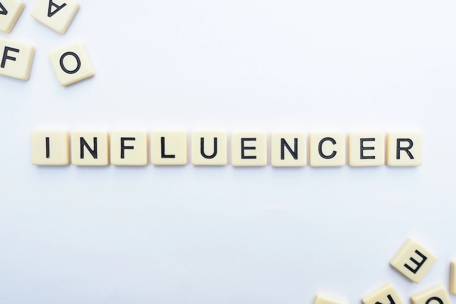Tile pieces spelling out INFLUENCER