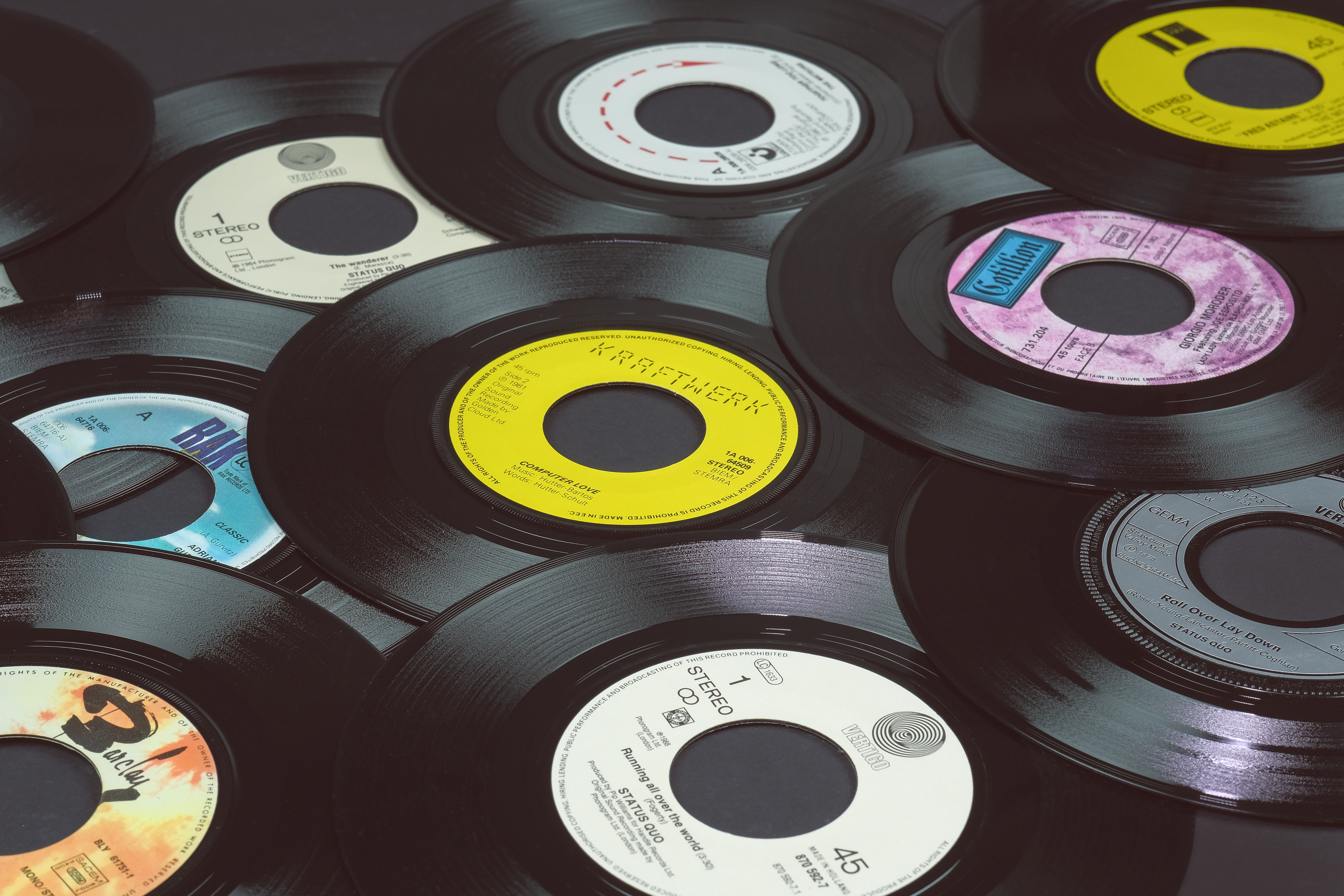 A stack of vinyl records laid on top of each other