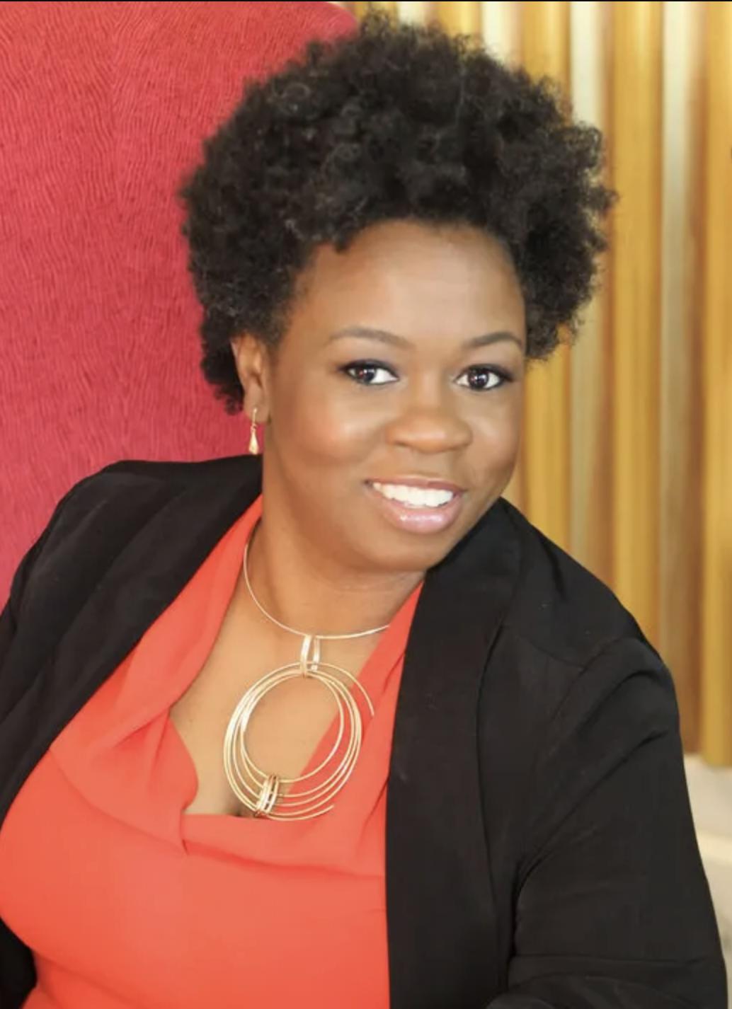 Headshot of Michele Heyward, a Black woman