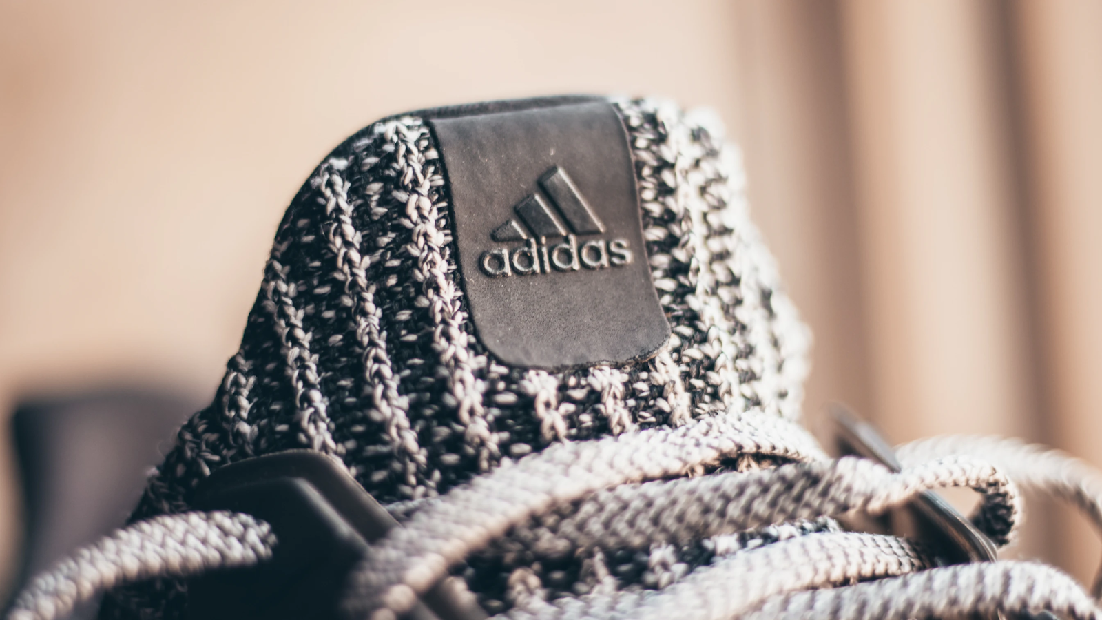 A close up photo of Adidas sneakers in a grey color