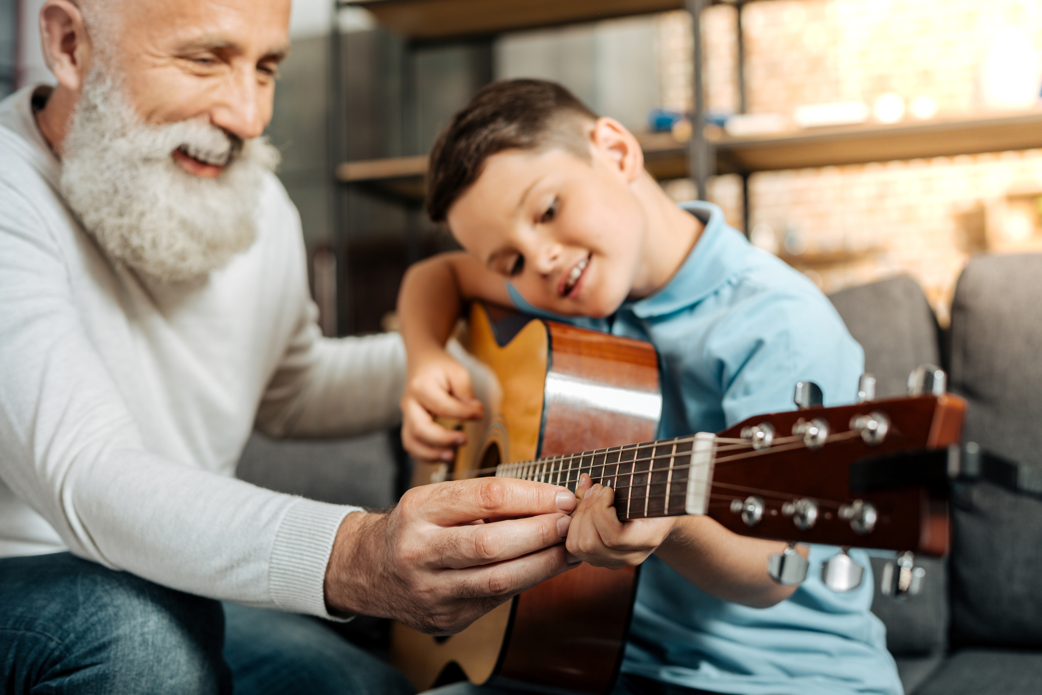 Quiver FInancial grandfather playing guitar with grandson