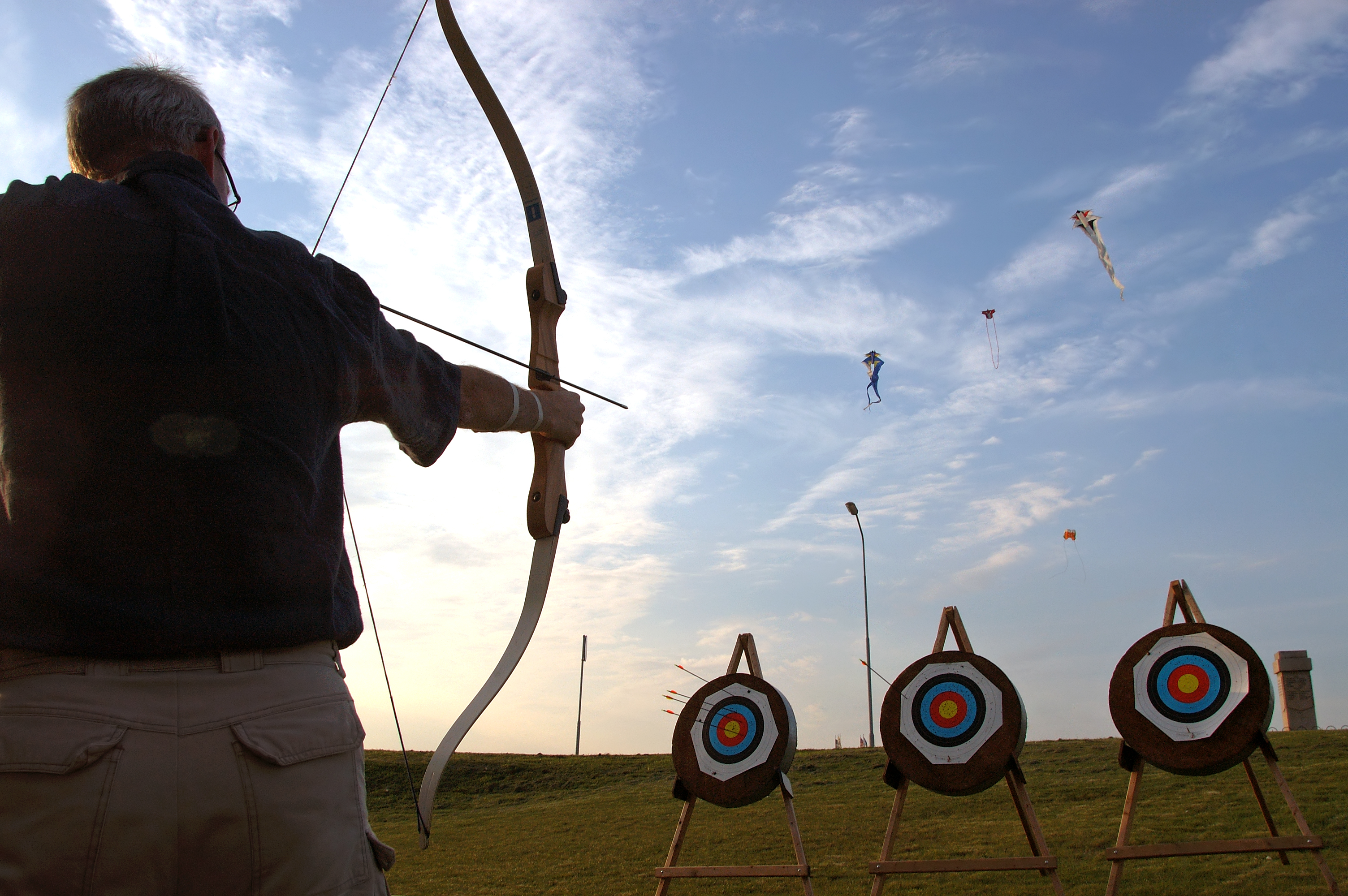 Quiver Financial archer aiming at targets
