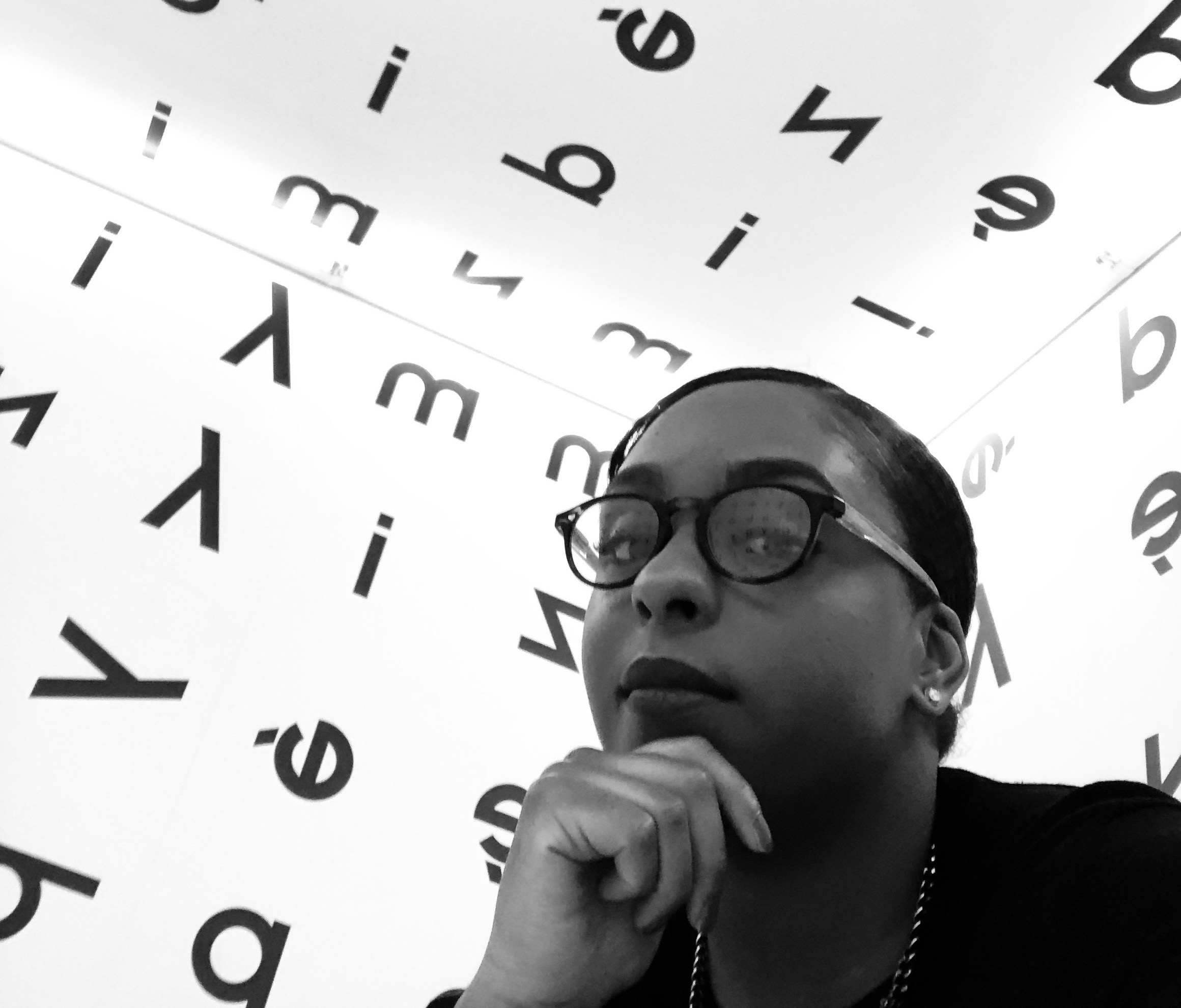 Naya Moss in black and white picture at the Museum of Contemporary Art in Krakow MOCAK.