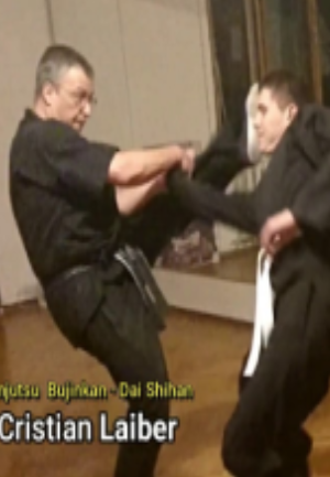 NKKF Instructor performs self defense with wrist lock and kick