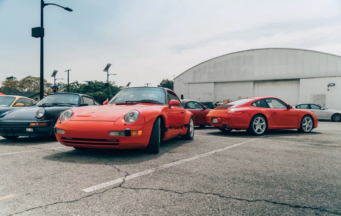 Red Porsches parked at event at airport