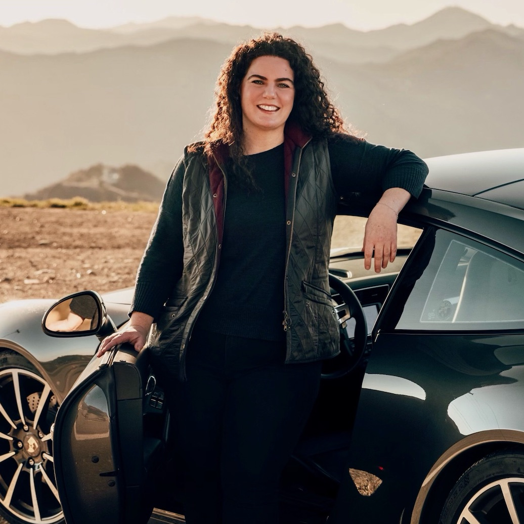 PCALA President, Mariana Small, standing in front of Porsche