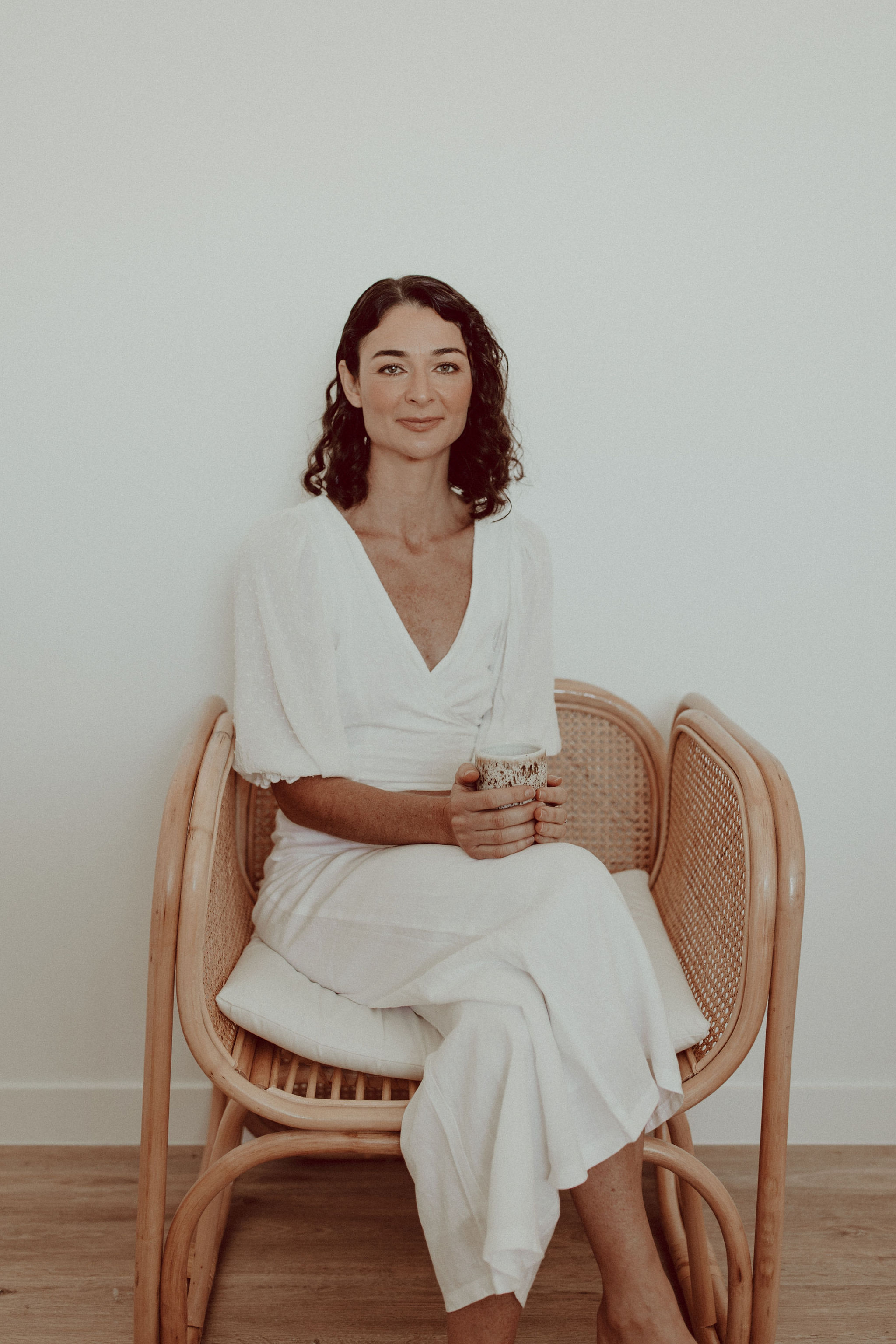 Eva Rose sitting in a chair