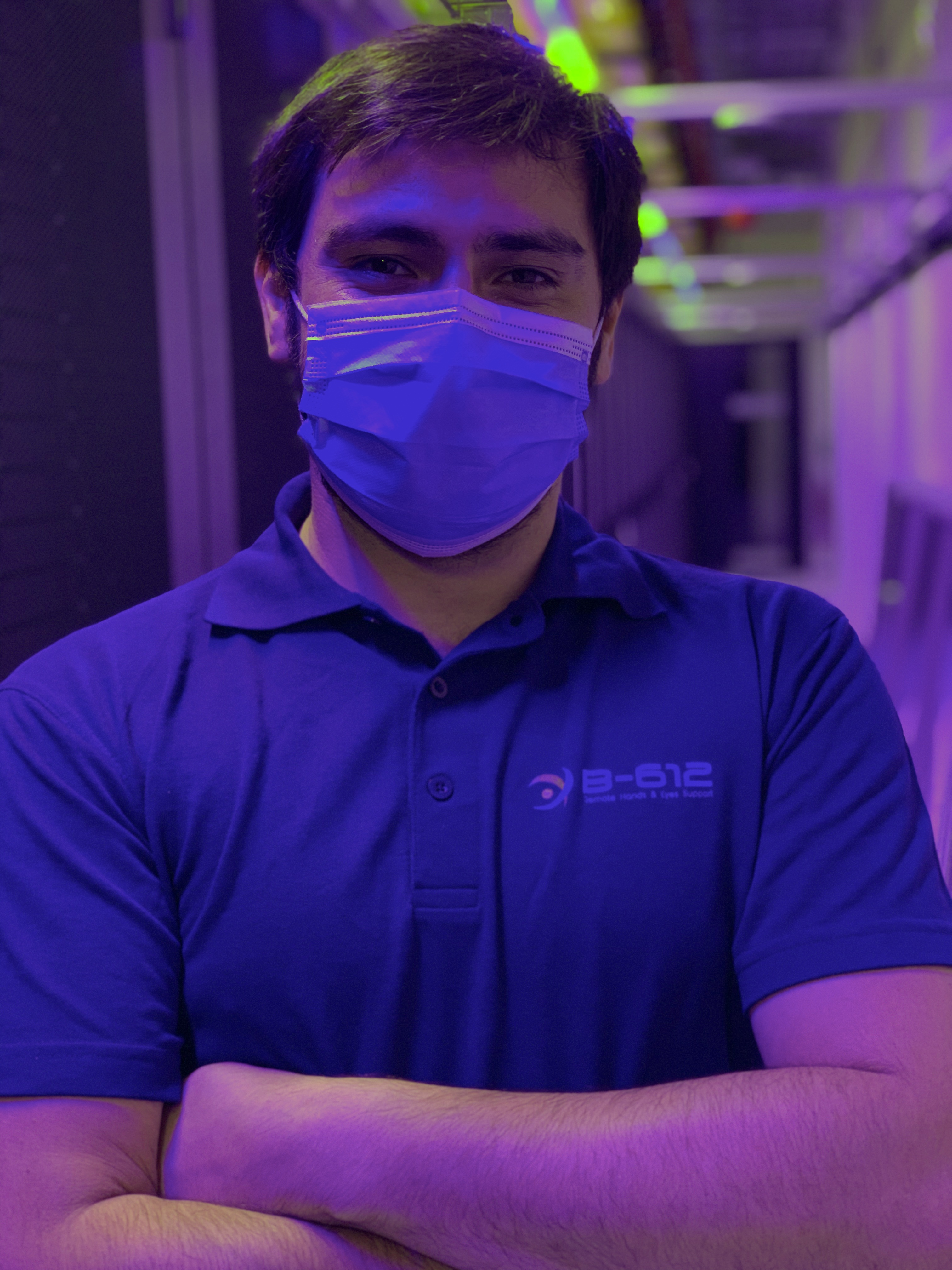 Engineer wearing Covid mask in a data center