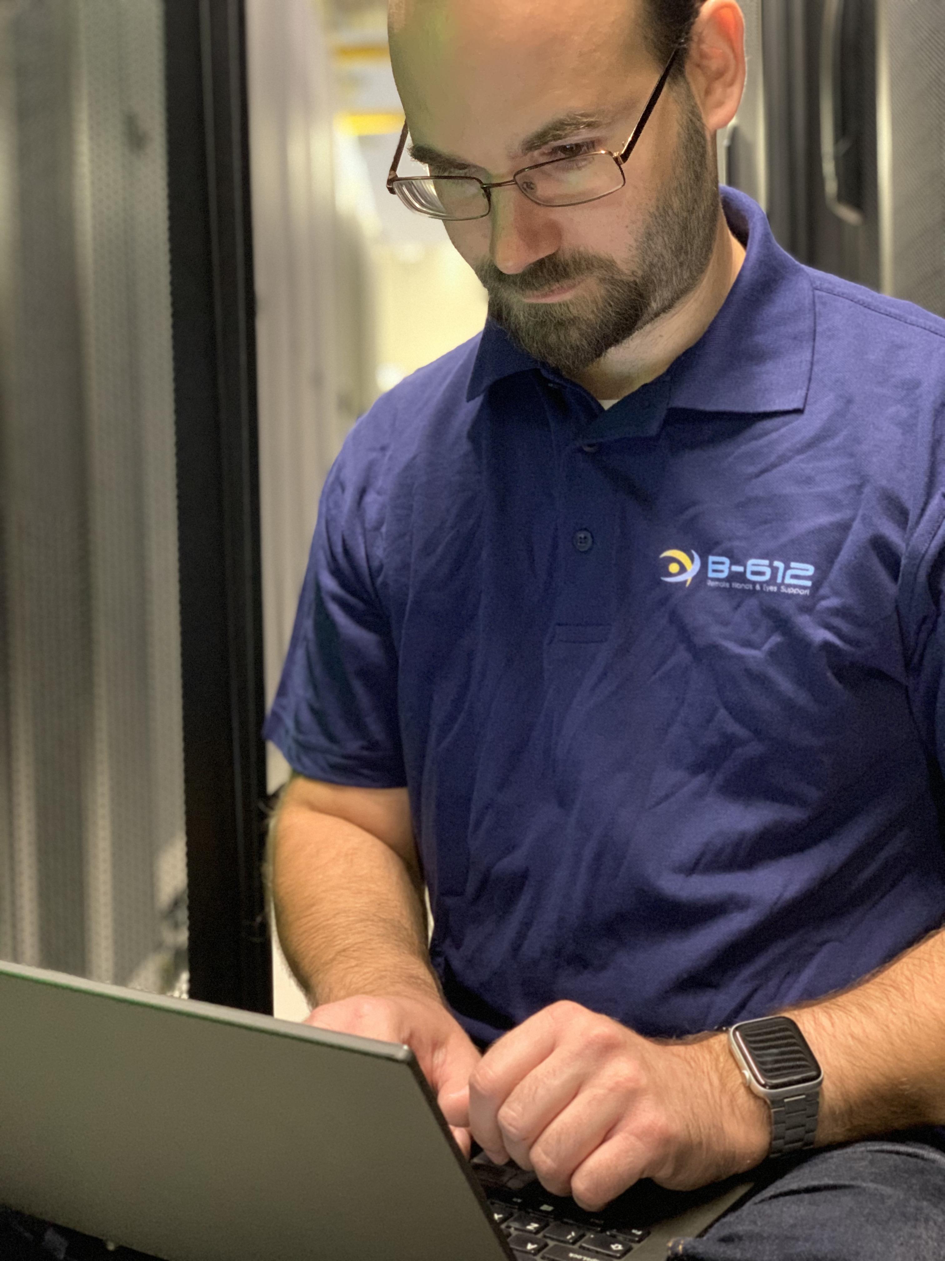 Engineer working inside a data center