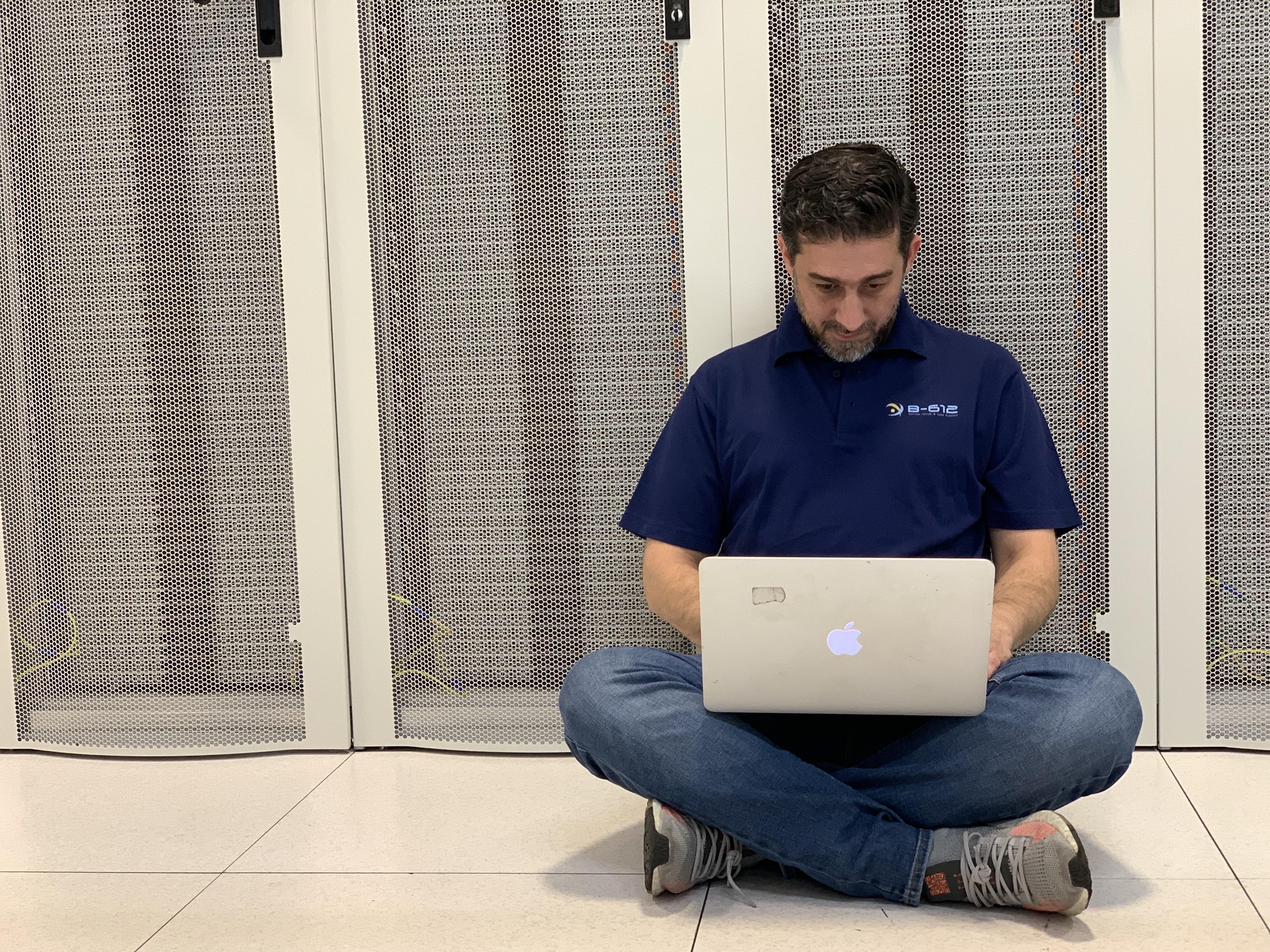 Sabah at work with laptop