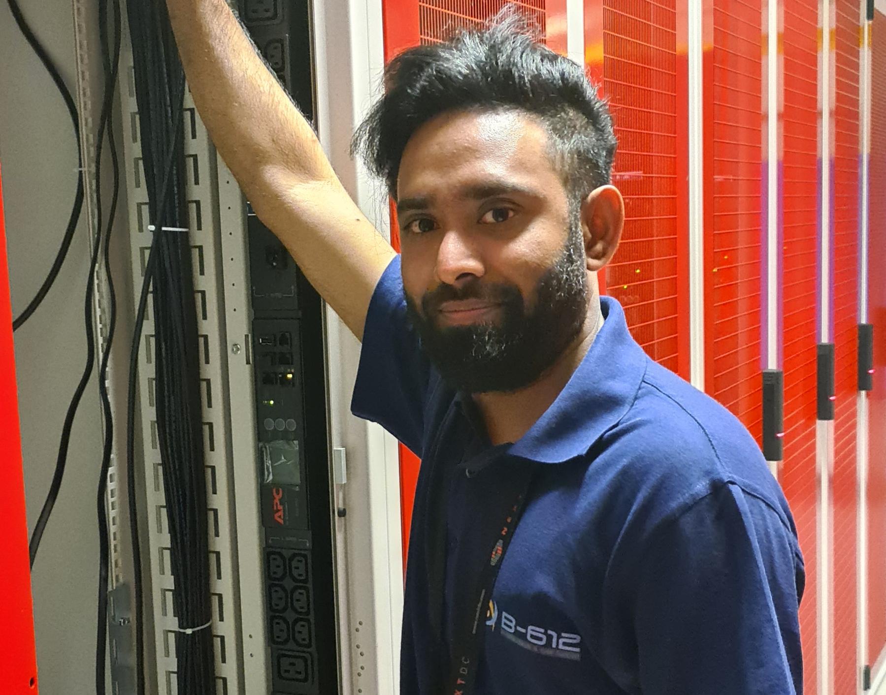 Engineer installing a rack inside a data center