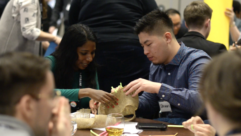 Building innovative shopping bags in a workshop at the 2018 Venture Out Conference.