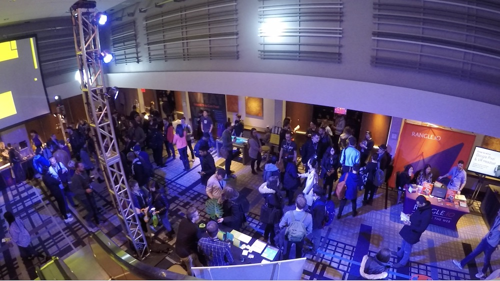 People mingling in the lobby of the FITC conference