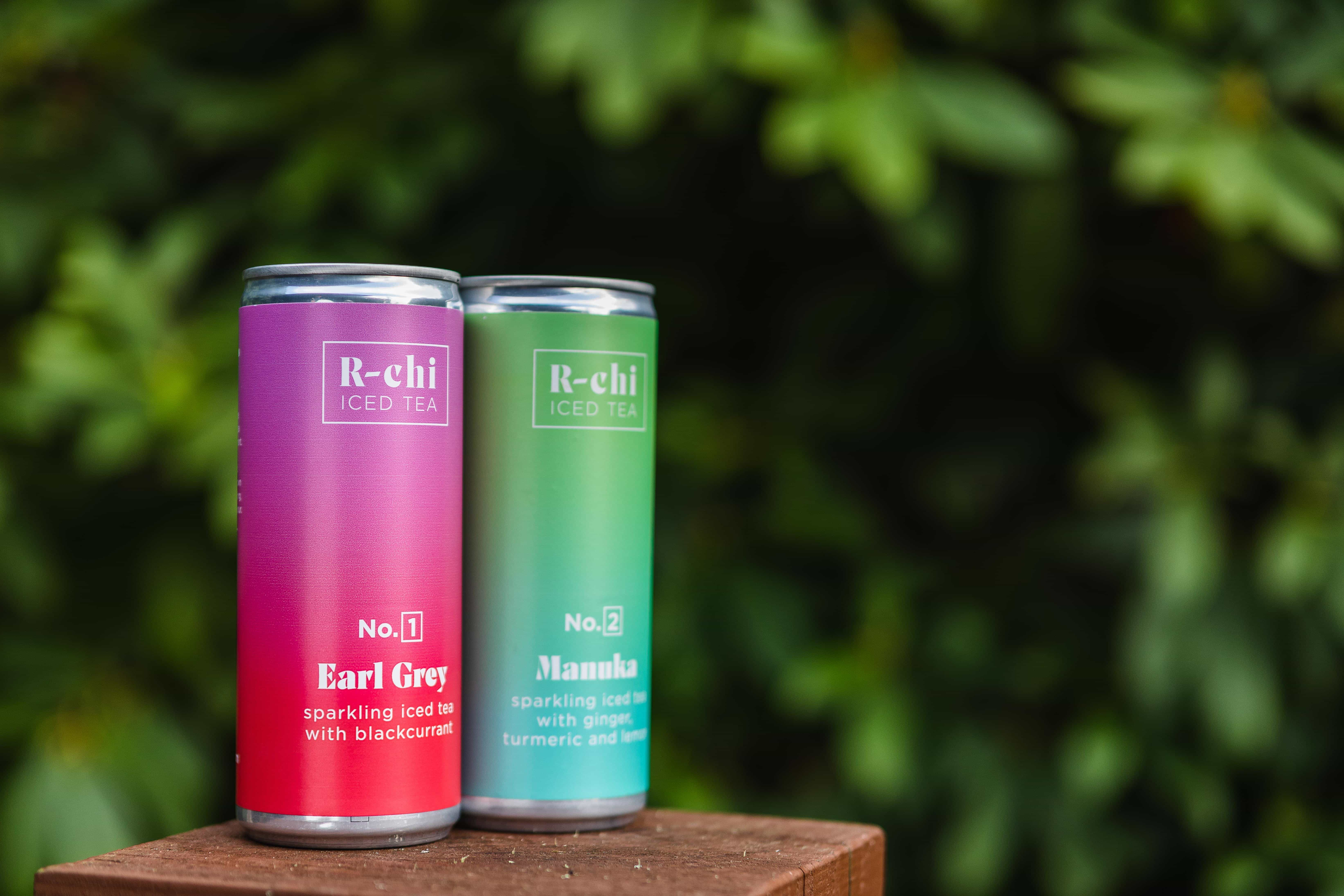 R-chi Iced tea Mixed case on a podium flavour. Brewed in Cornwall by Archie Boscawen. Pink and green drinks cans.