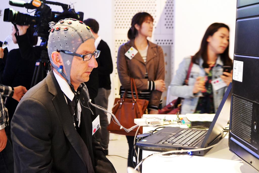 Image of a man with an EEG (brain sensor) cap