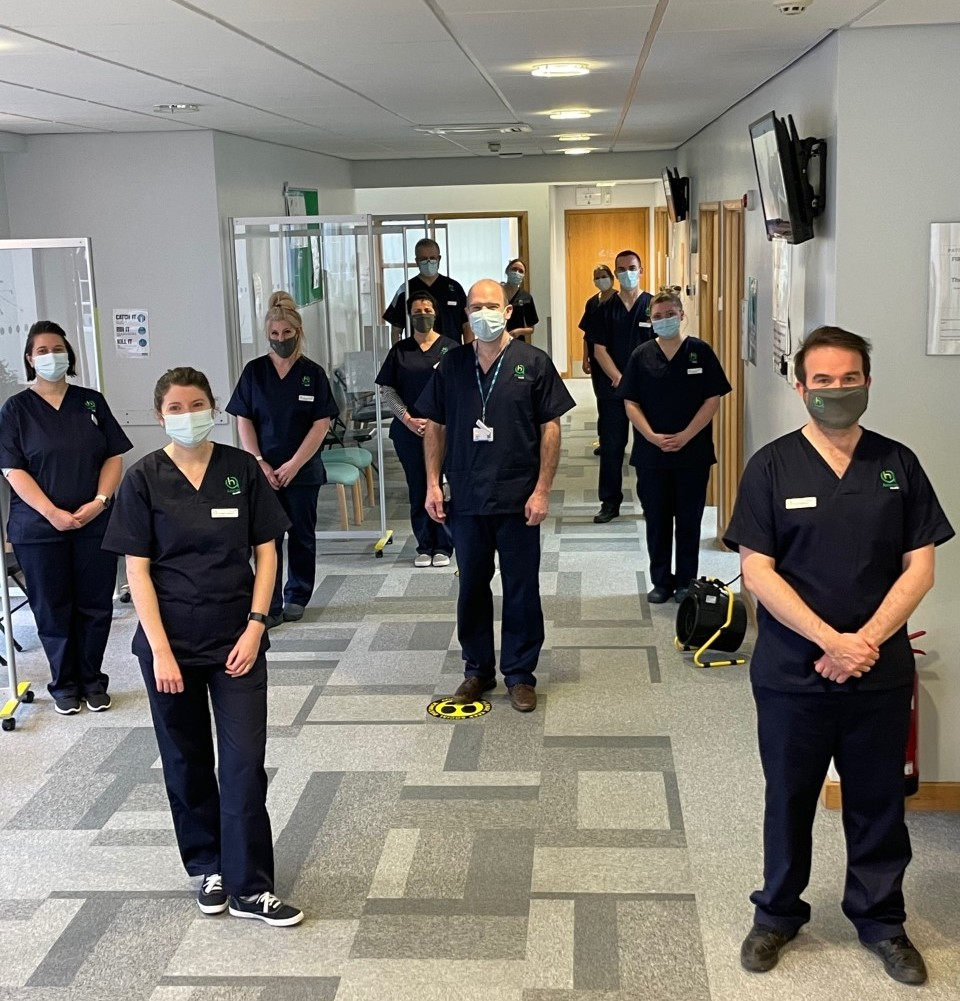 Amicus Health GPs wearing scrubs and face masks