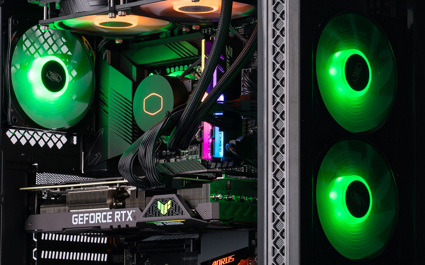 A picture of an ABS Gladiator PC with green RGB components in the case that's shot at an angle to display the internal components of the PC.